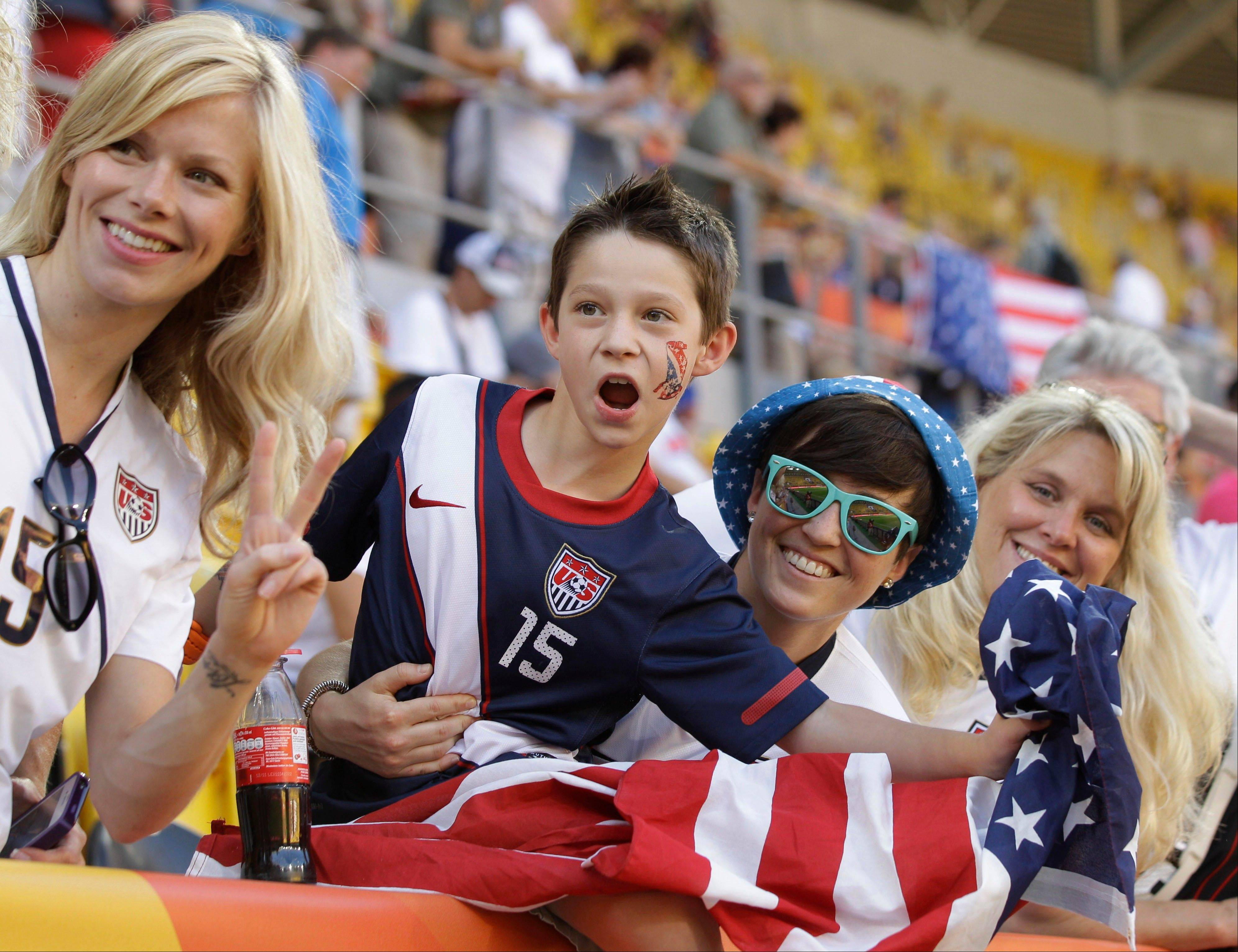 United States fans cheer during the World Cup match against North Korea on Tuesday.