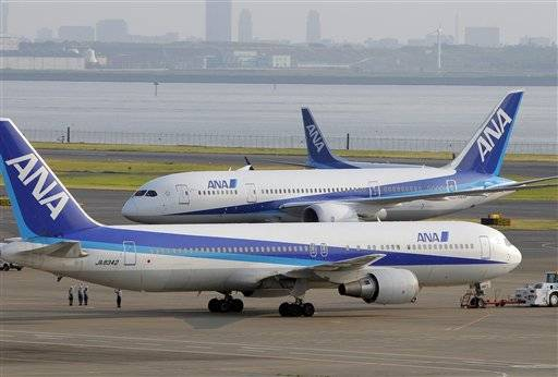 Japan's All Nippon Airways (ANA) Boeing 787, middle, taxis near a Boing 767, foreground, as the first delivery to the Japanese airline upon arrival from Seattle, Wash., at Tokyo's Haneda International Airport in Tokyo, Sunday.