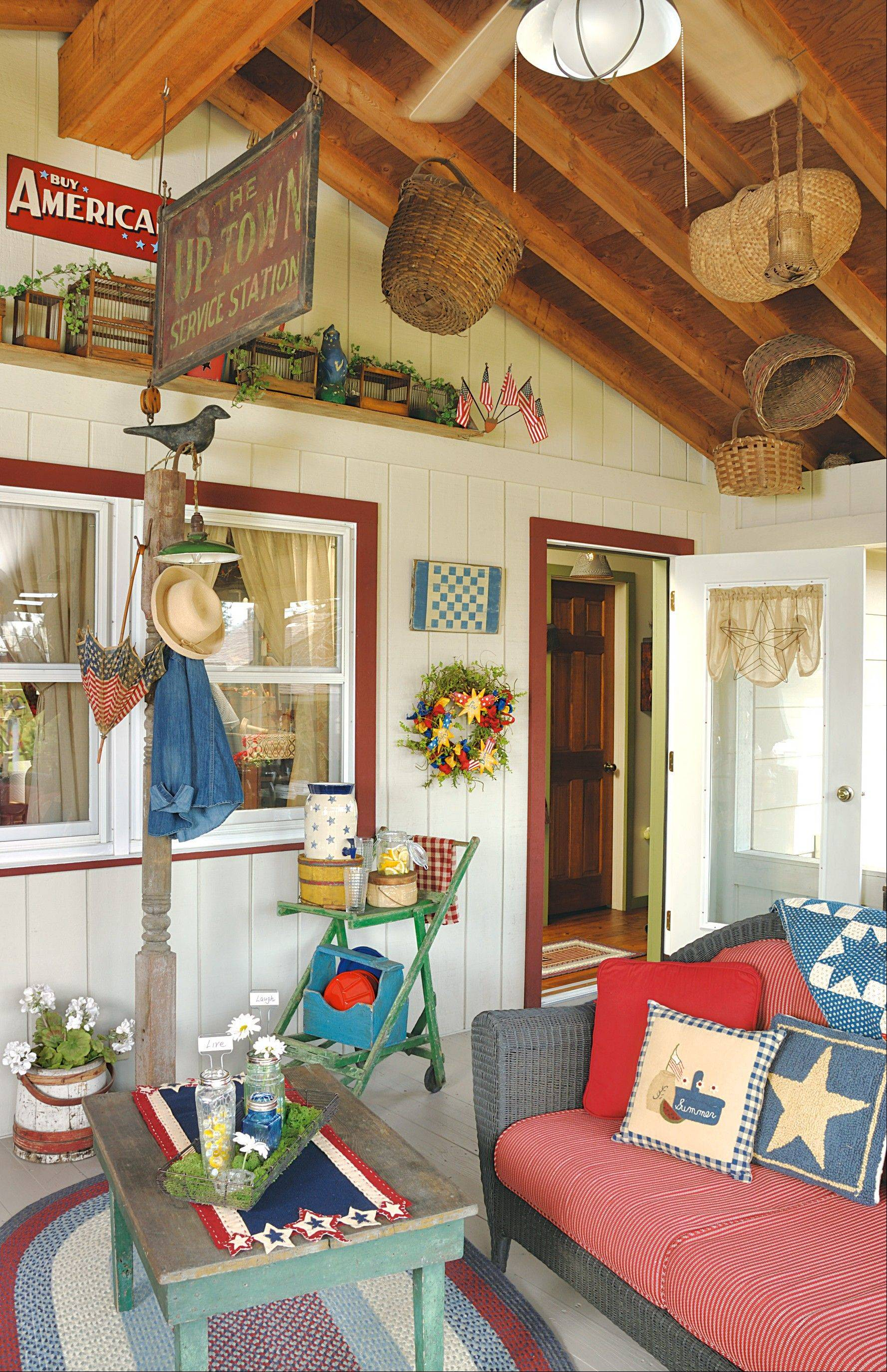 The vaulted ceiling is a perfect place for displaying treasures like antique signs and baskets.