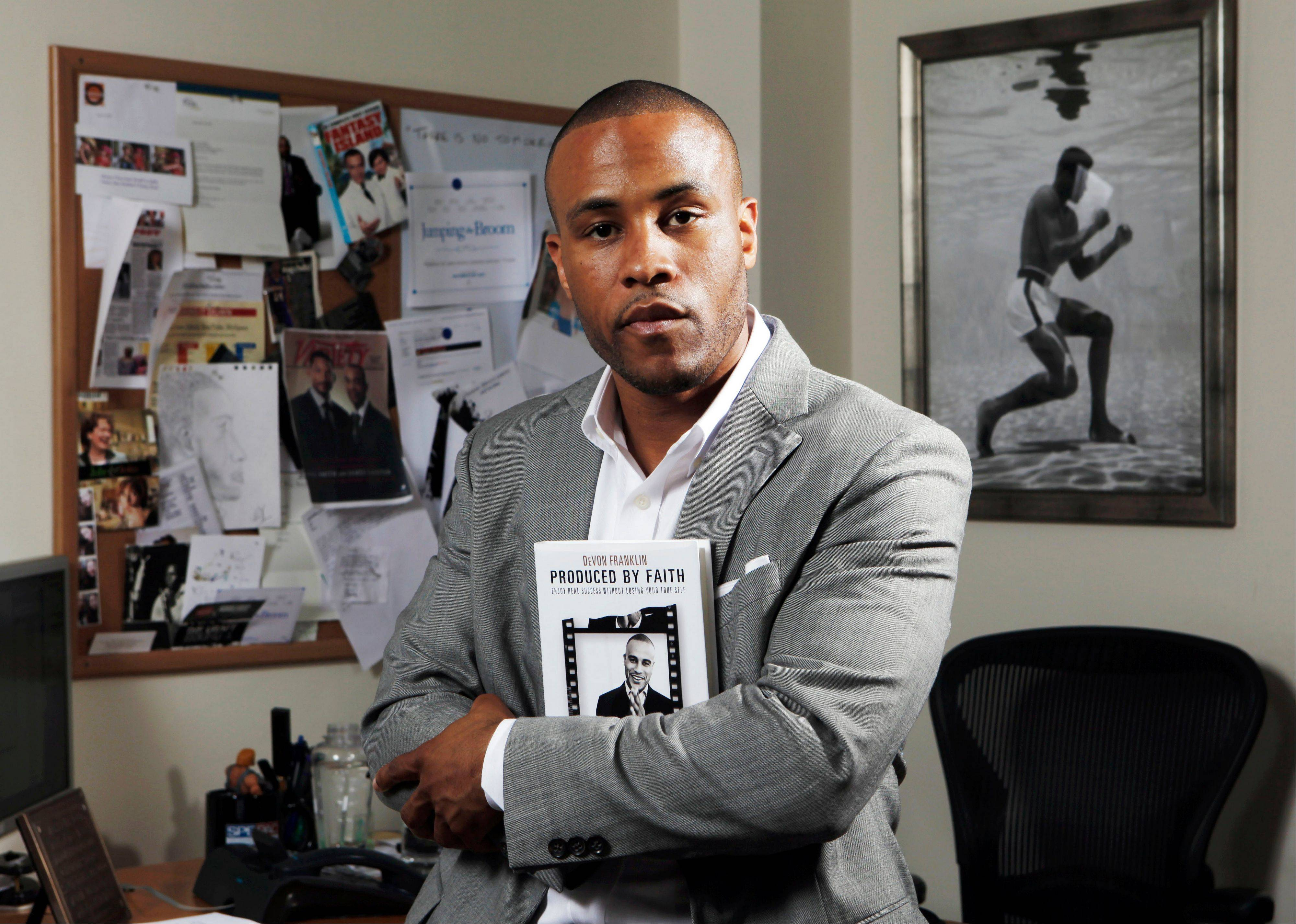DeVon Franklin, Sony vice president of production and author of �Produced by Faith: Enjoy Real Success without Losing Your True Self,� poses in his office at Sony Pictures Entertainment in Culver City, Calif.. Producers of faith-based movies have a message for Hollywood studios: Make the movies and customers will pay to watch them.