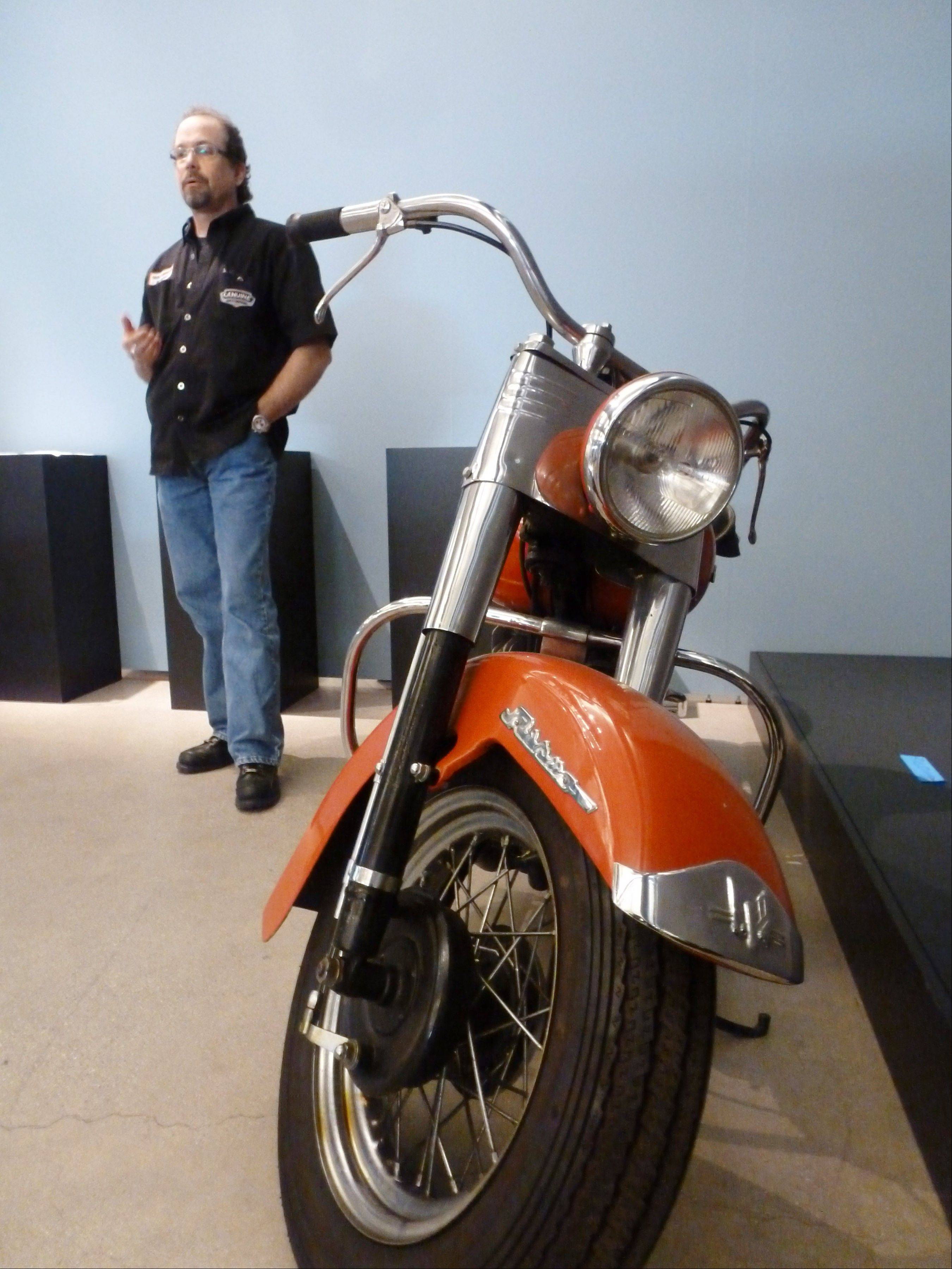 Bill Davidson, great-grandson of Harley-Davidson Motor Company co-founder, shows off the Rikuo motorcycle at the Harley-Davidson museum in Milwaukee. The Rikuo model was the first motorcycle manufactured in Japan.