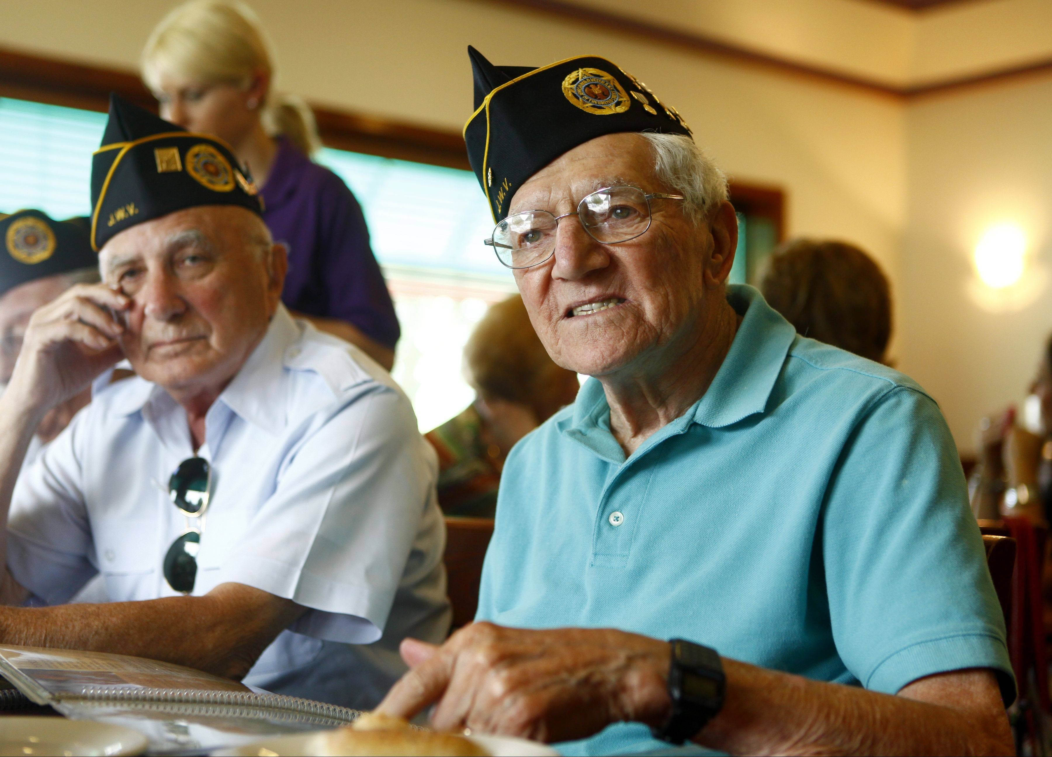 Al Kamikow, right, of Buffalo Grove, talks about his time in the service during World War II while fellow member, Michael Hoff, of Lake Forest, listens last week. Kamikow and Hoff are members of the Buffalo Grove Post 89.