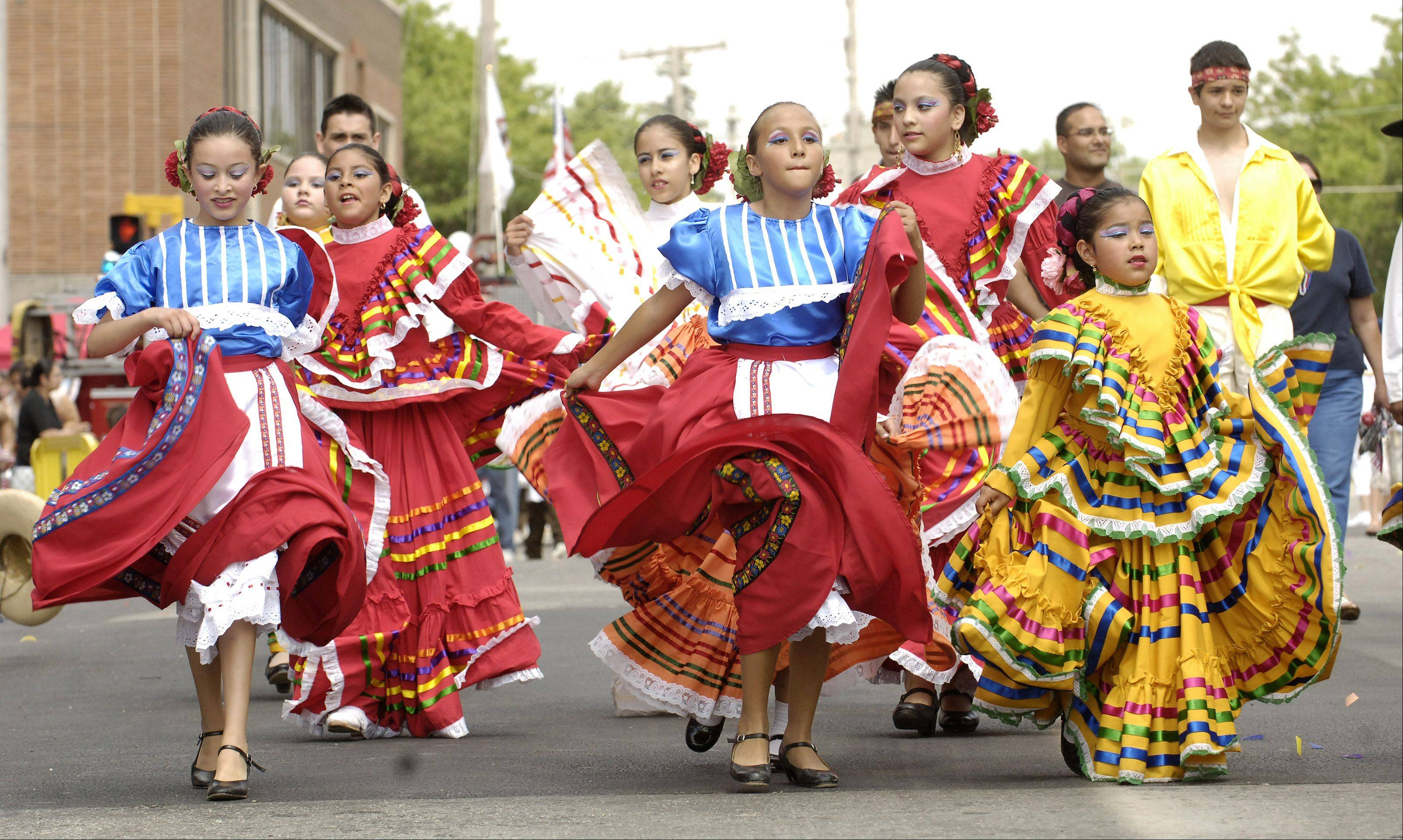 Dancers from Ballet Folklorico Quetzalcoatl perform during a previous Fourth of July parade in downtown Aurora. This year�s parade will feature about 70 entries.