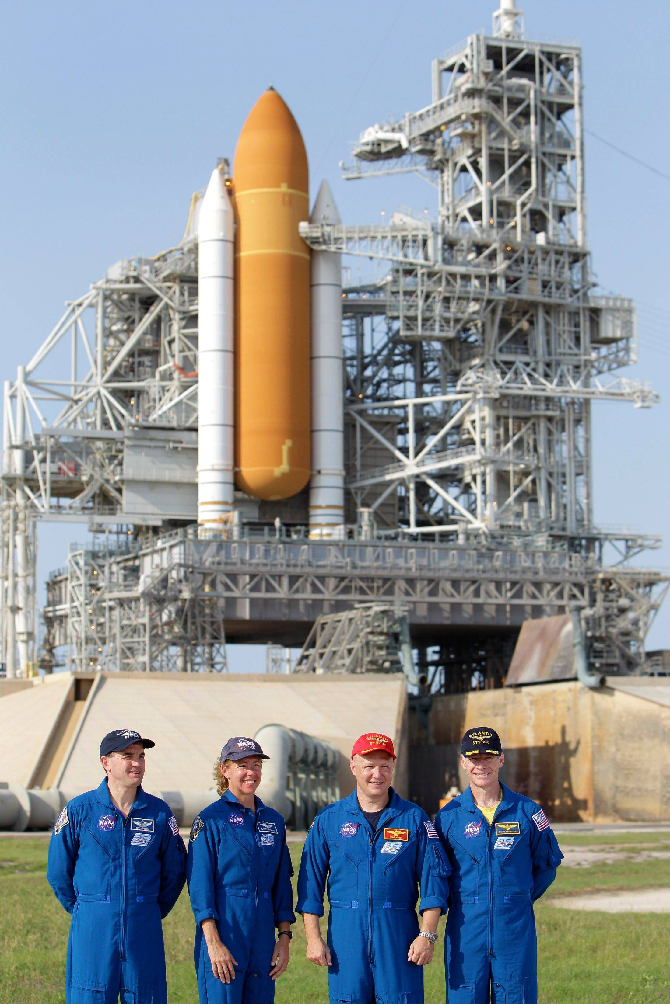 The crew of space shuttle Atlantis, from left, mission specialist Rex Walhiem, mission specialist Sandy Magnus, pilot Doug Hurley and commander Chris Ferguson attend a news conference at Pad 39A during the Terminal Countdown Demonstration Test at the Kennedy Space Center in Cape Canaveral, Fla. The launch of Atlantis, the final space shuttle mission, is scheduled for July 8.