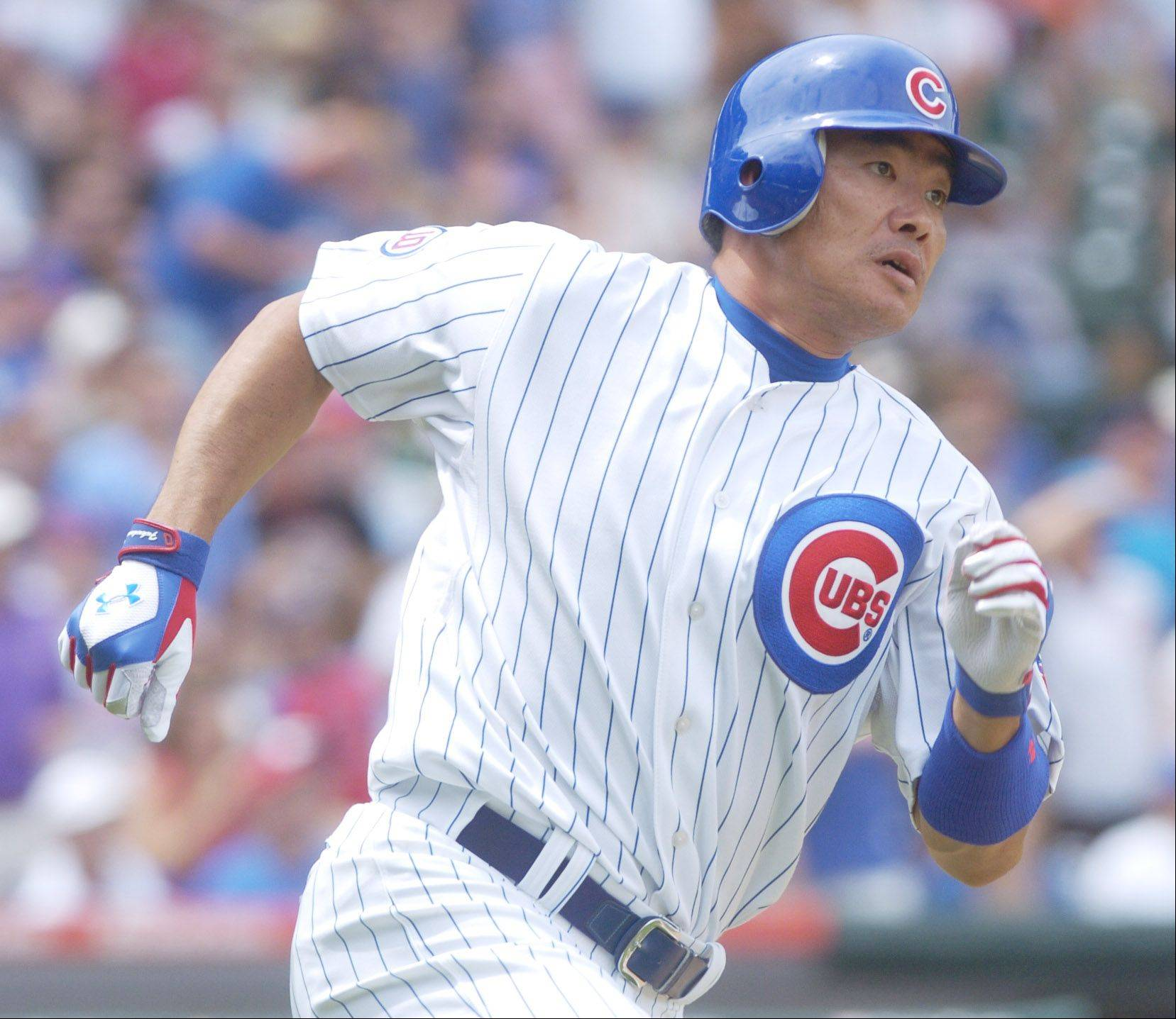 Kosuke Fukudome of the Cubs hustles after hitting a double during the third inning against the White Sox Sunday at Wrigley Field.