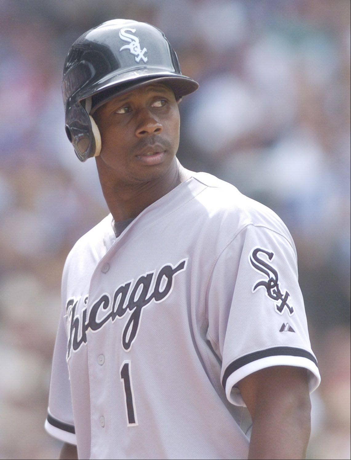 Juan Pierre of the White Sox walks back to the dugout after popping out to third during the eight inning of Sunday's game against the Cubs at Wrigley Field.