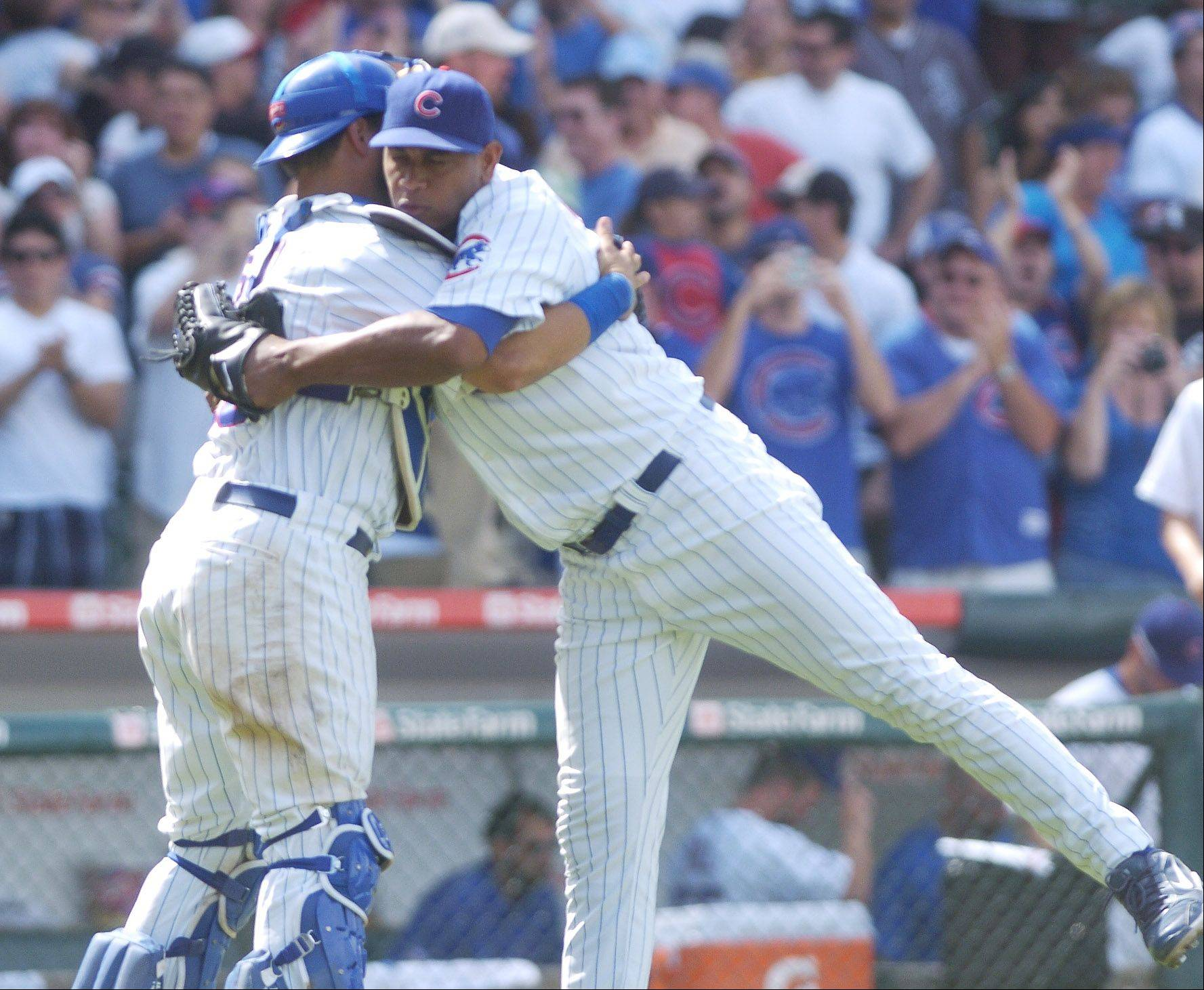 Cubs closer Carlos Marmol gets a hug from catcher Geovany Soto after earning a save while pitching 1-1/3 innings in Sunday's 3-1 victory against the White Sox at Wrigley Field.