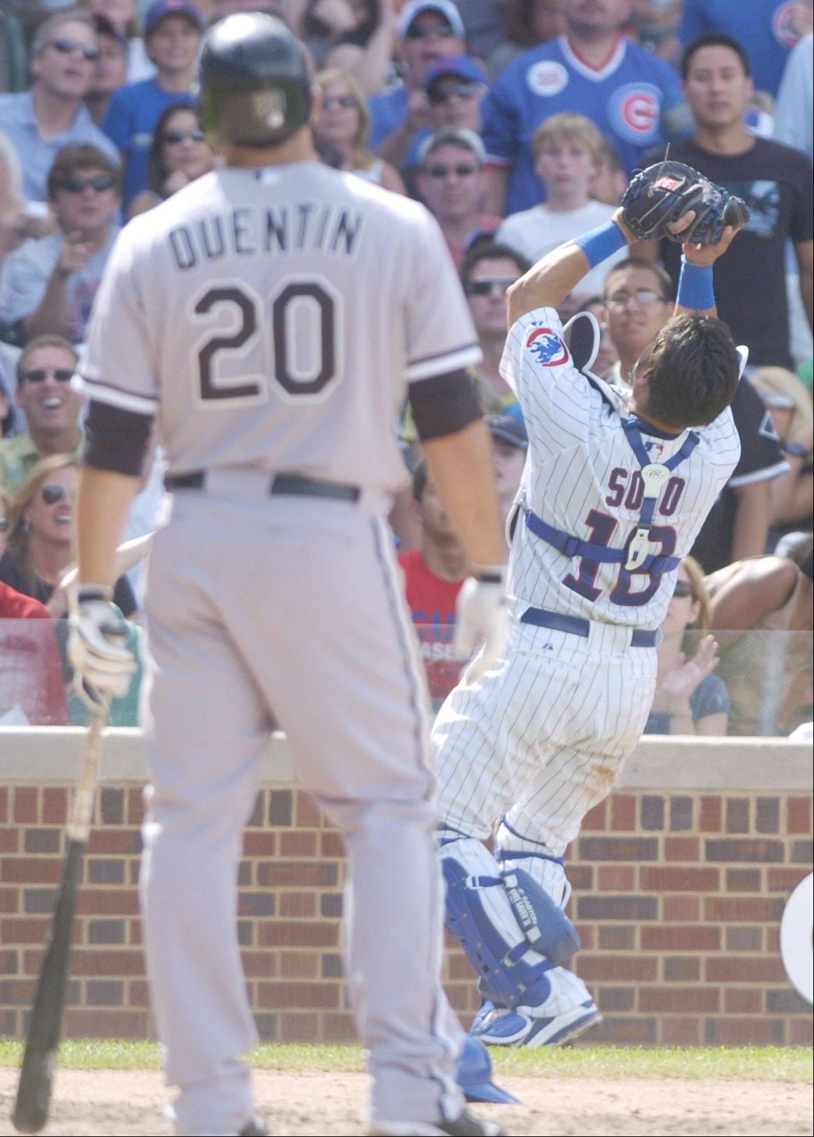 Carlos Quentin of the White Sox pops out to Cubs catcher Geovany Soto during the ninth inning of Sunday's game at Wrigley Field.