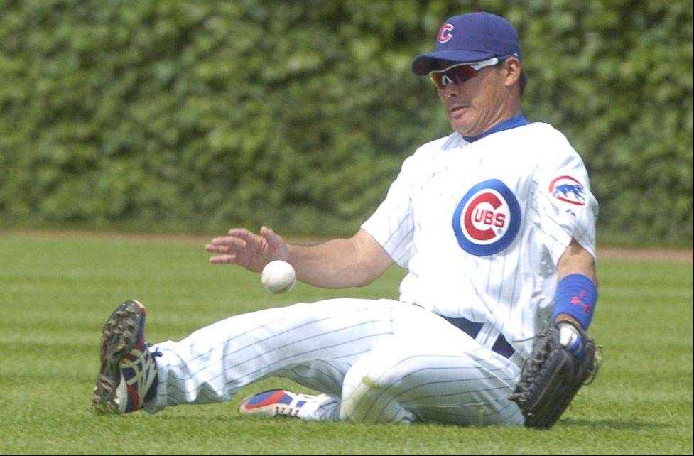 Cubs right fielder Kosuke Fukudome makes a sliding stop of a base hit during Sunday's game against the White Sox at Wrigley Field.