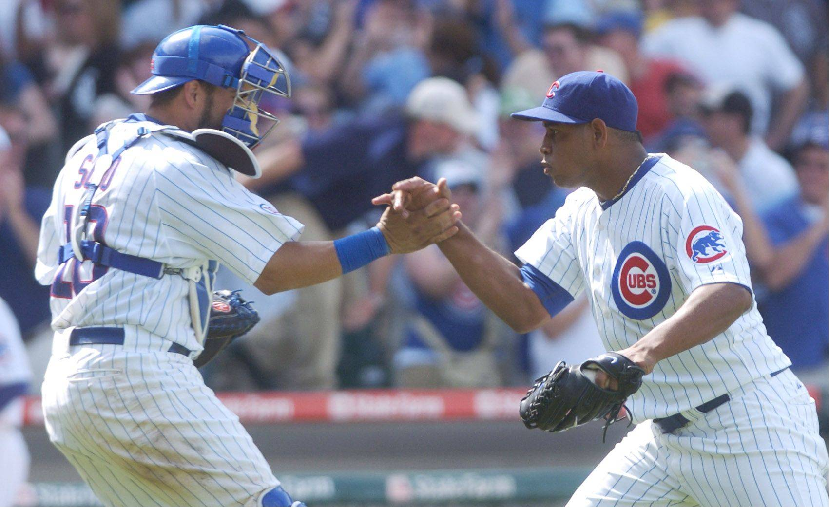 Cubs closer Carlos Marmol gets congratulated by catcher Geovany Soto after earning a save while pitching 1-1/3 innings in Sunday's 3-1 victory against the White Sox at Wrigley Field