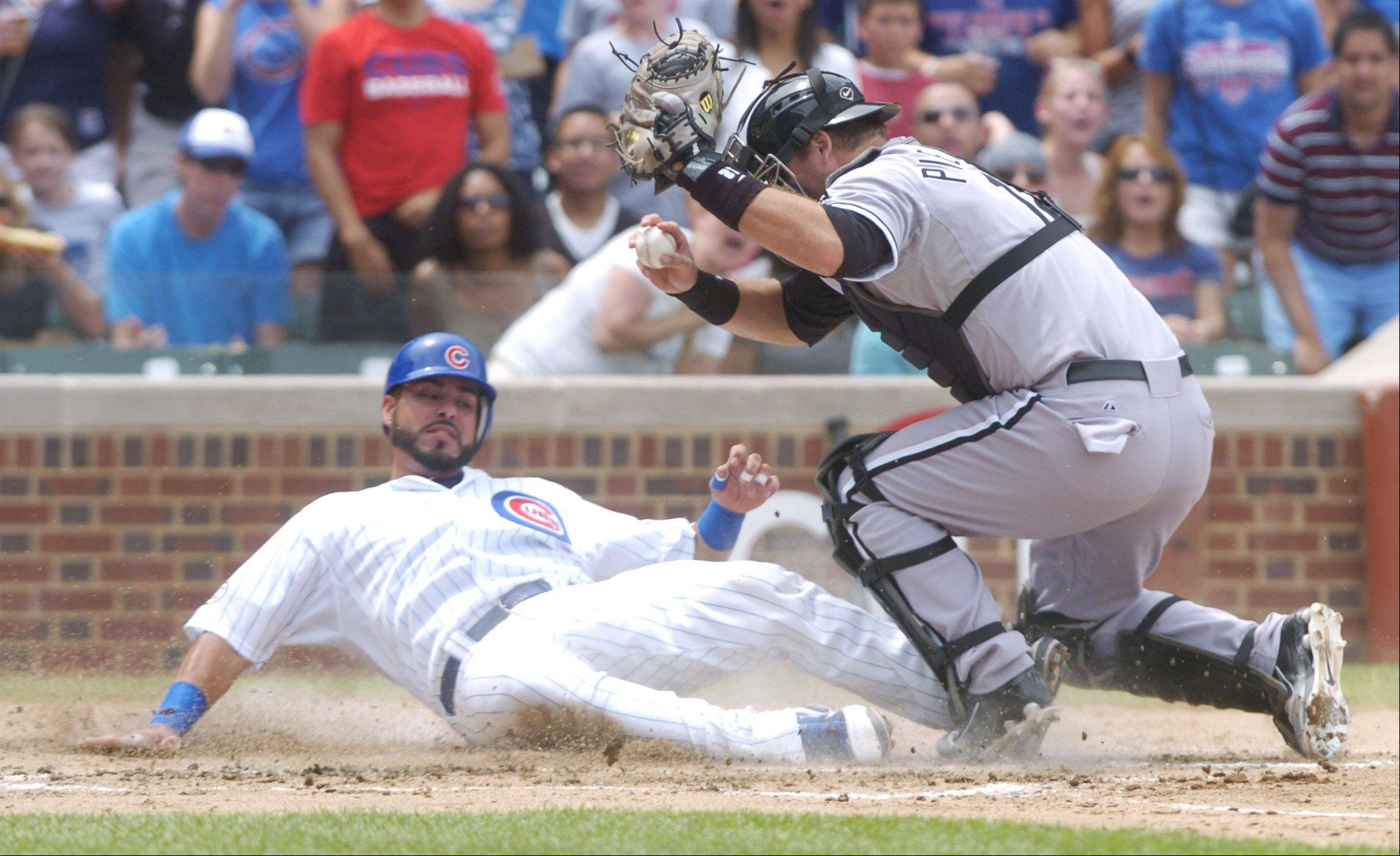 Geovany Soto of the Cubs gets tagged out at the plate by White Sox catcher A.J. Pierzynski to end the third inning of Sunday's game at Wrigley Field.