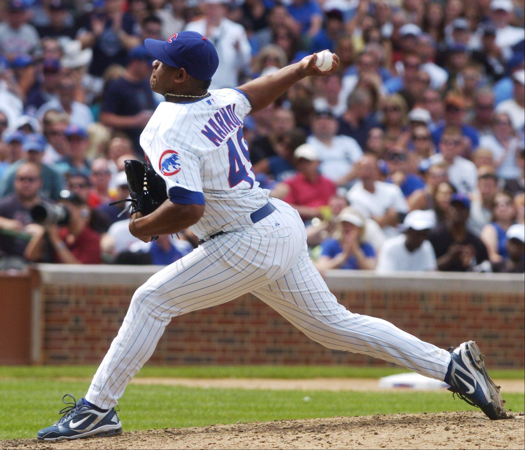 Cubs closer Carlos Marmol strikes out Alexei Ramirez of the White Sox to end the eighth inning of Sunday's game at Wrigley Field.
