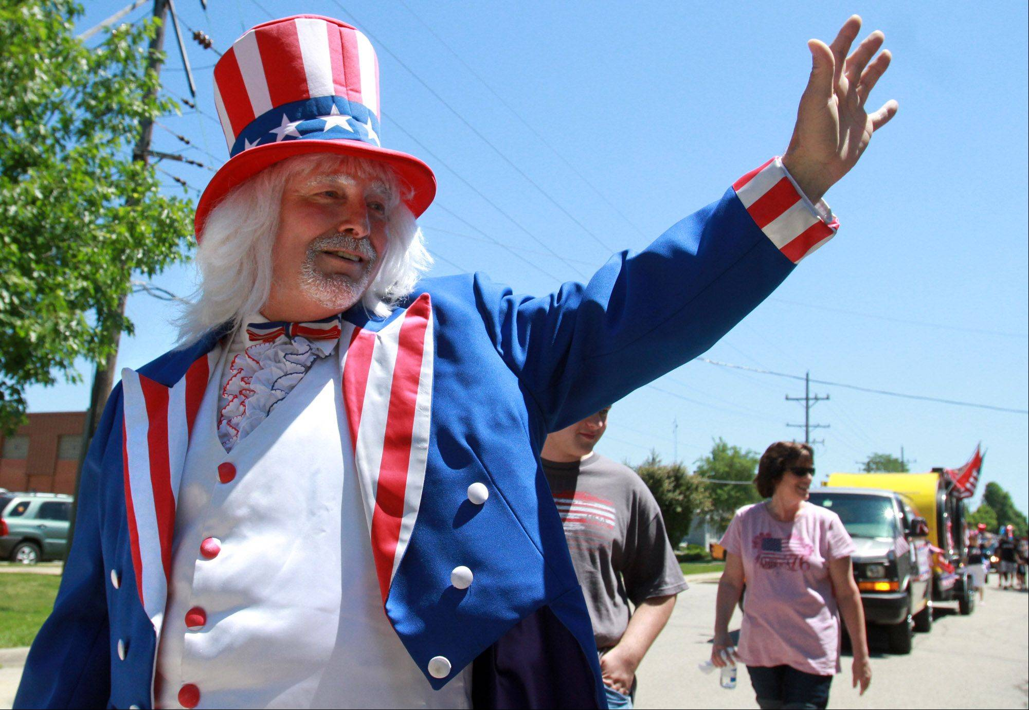 Joe Boshold, a manager at Northrop Grumman Corporation, marches in the Rolling Meadows Fourth of July parade Monday.