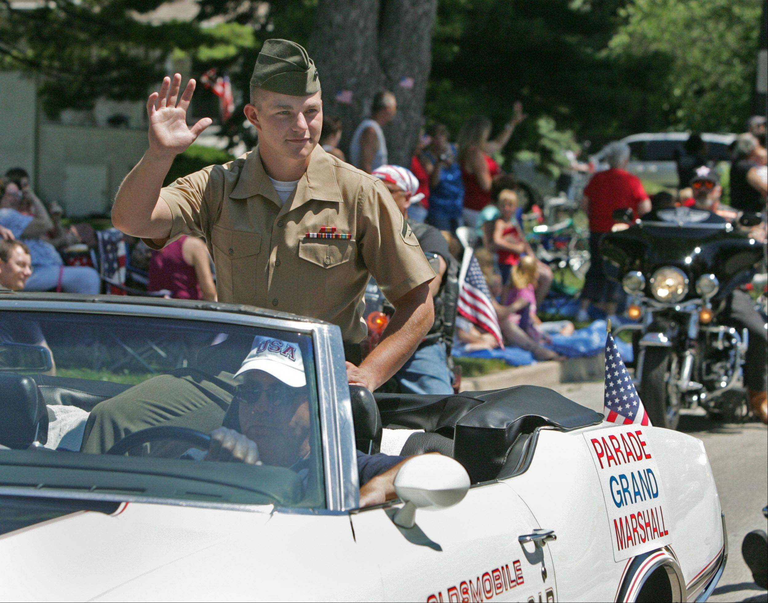 Daniel white/Dwhite@dailyherald.com A young Marine, Andrew Pickerill, is the grand marshal of the Villa Park Fourth of July parade. He is back for one month, before returning to Afghanistan.