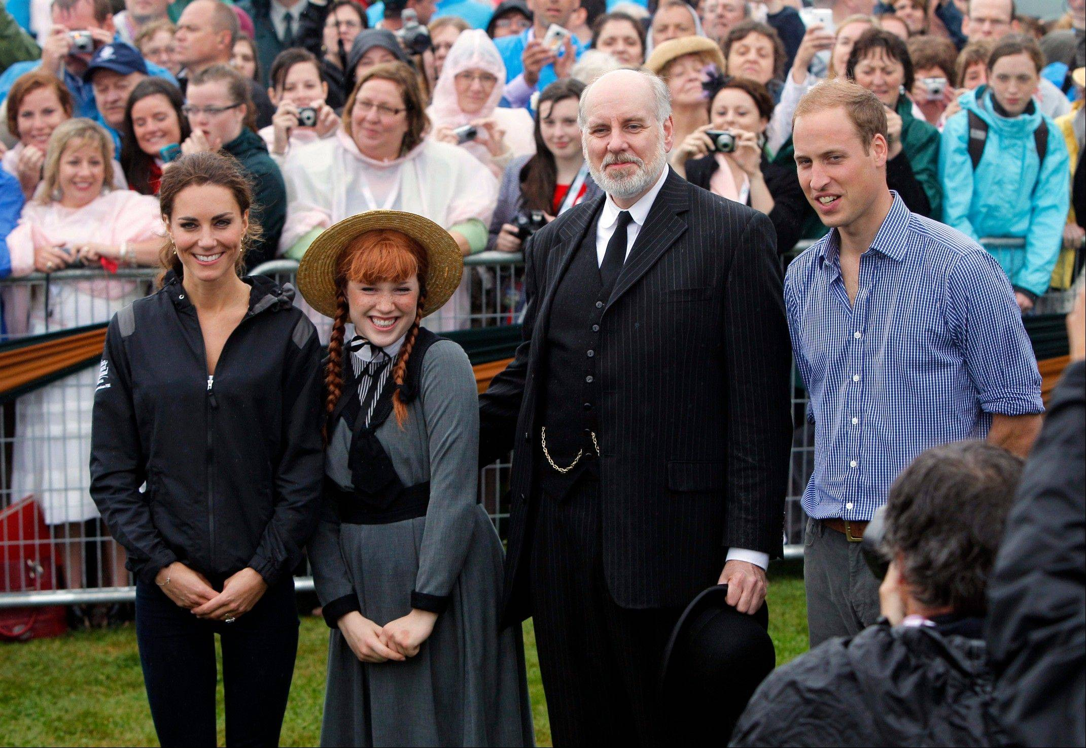 Prince William and his wife Kate, the Duke and Duchess of Cambridge, poses with Anne of Green Gables characters in Dalvay-by-the-Sea on Prince Edward Island as part of their Royal Tour of Canada, Monday, July 4, 2011.