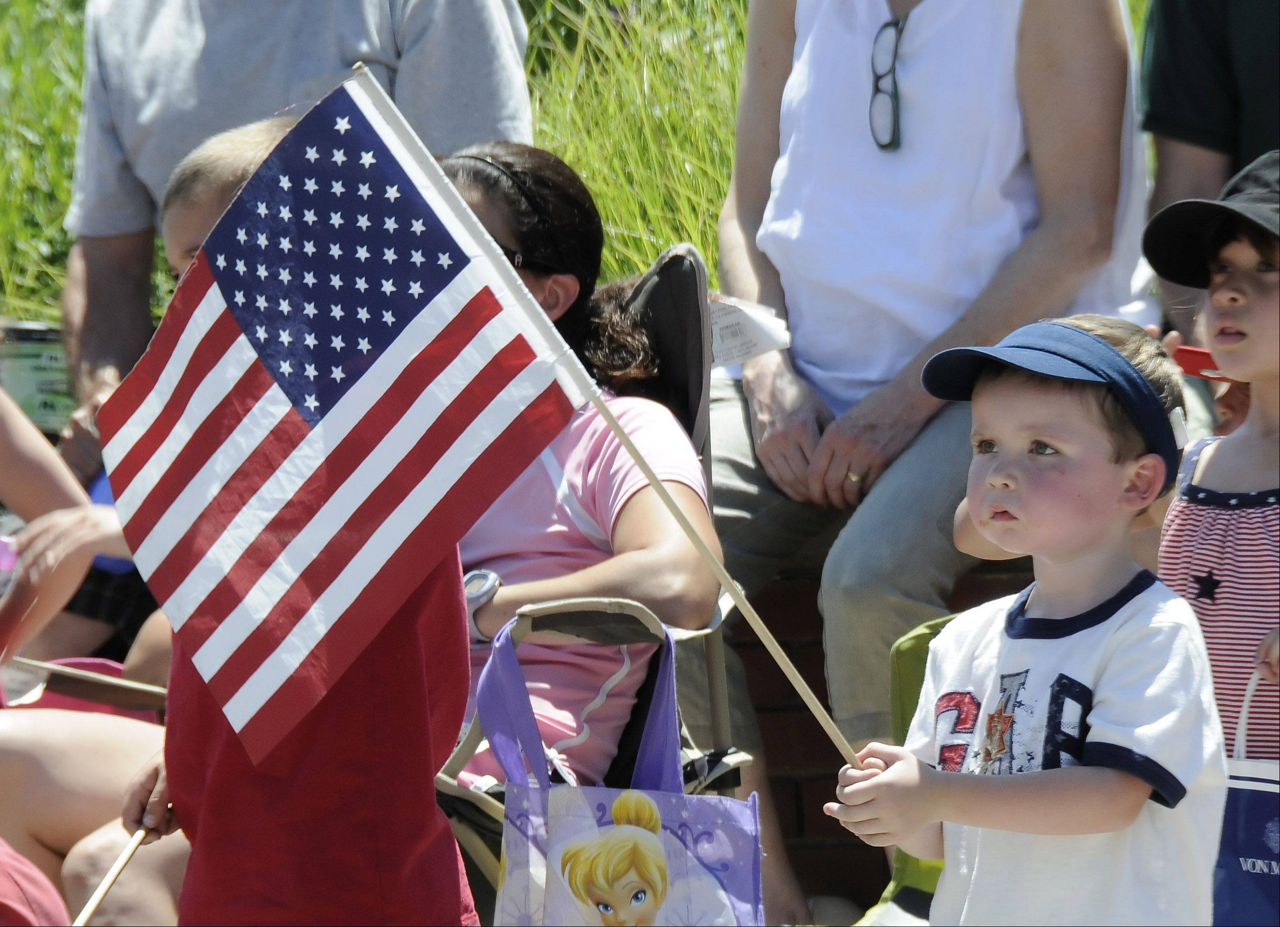Jeffrey Syme from Winfield, shows his solemn patriotic side at Glen Ellyn's Independence Day parade.