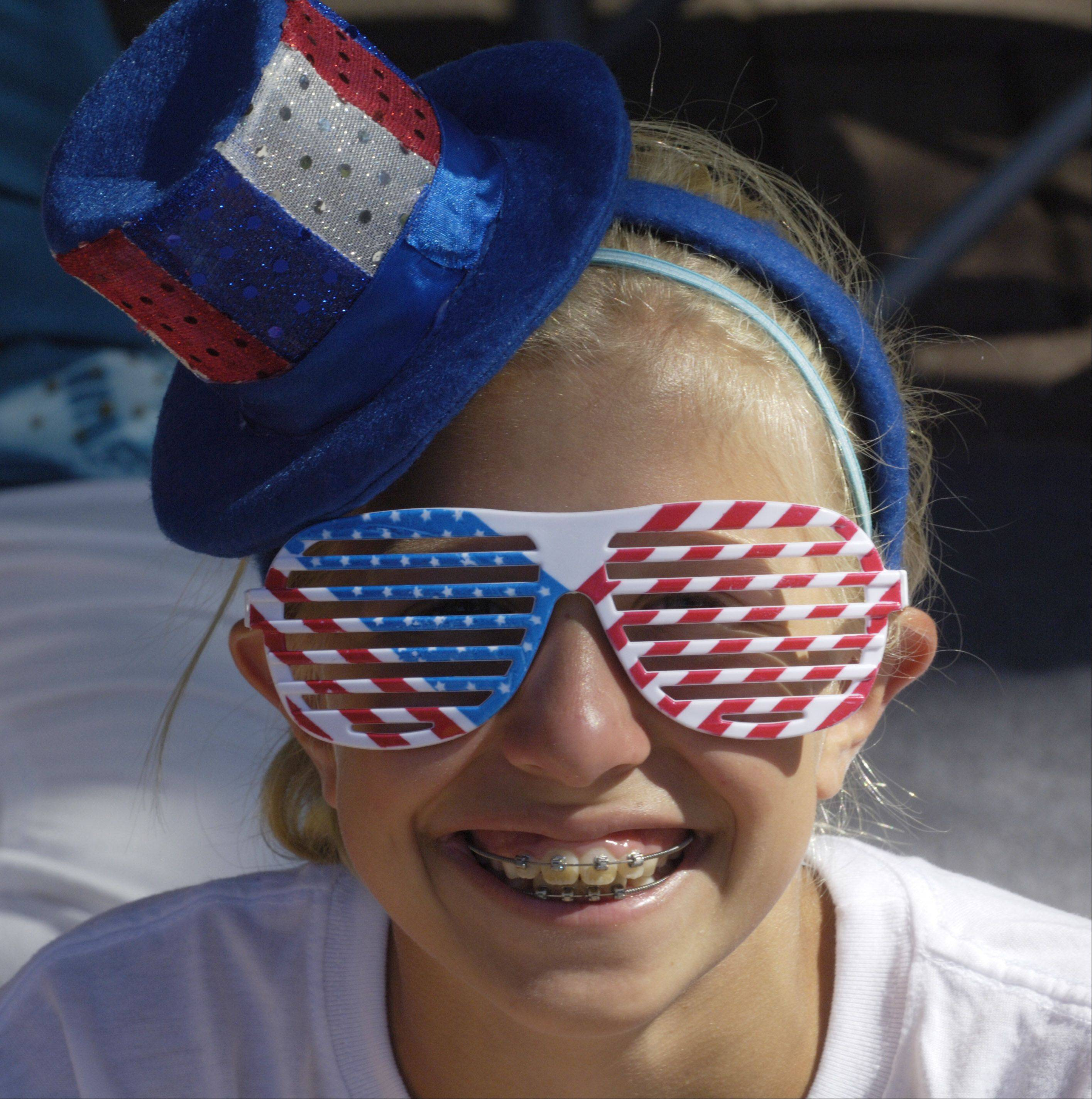 Emily Schulstad, 10, of Arlington Heights is bedecked for the day as she waits for the village's Fourth of July parade Monday.