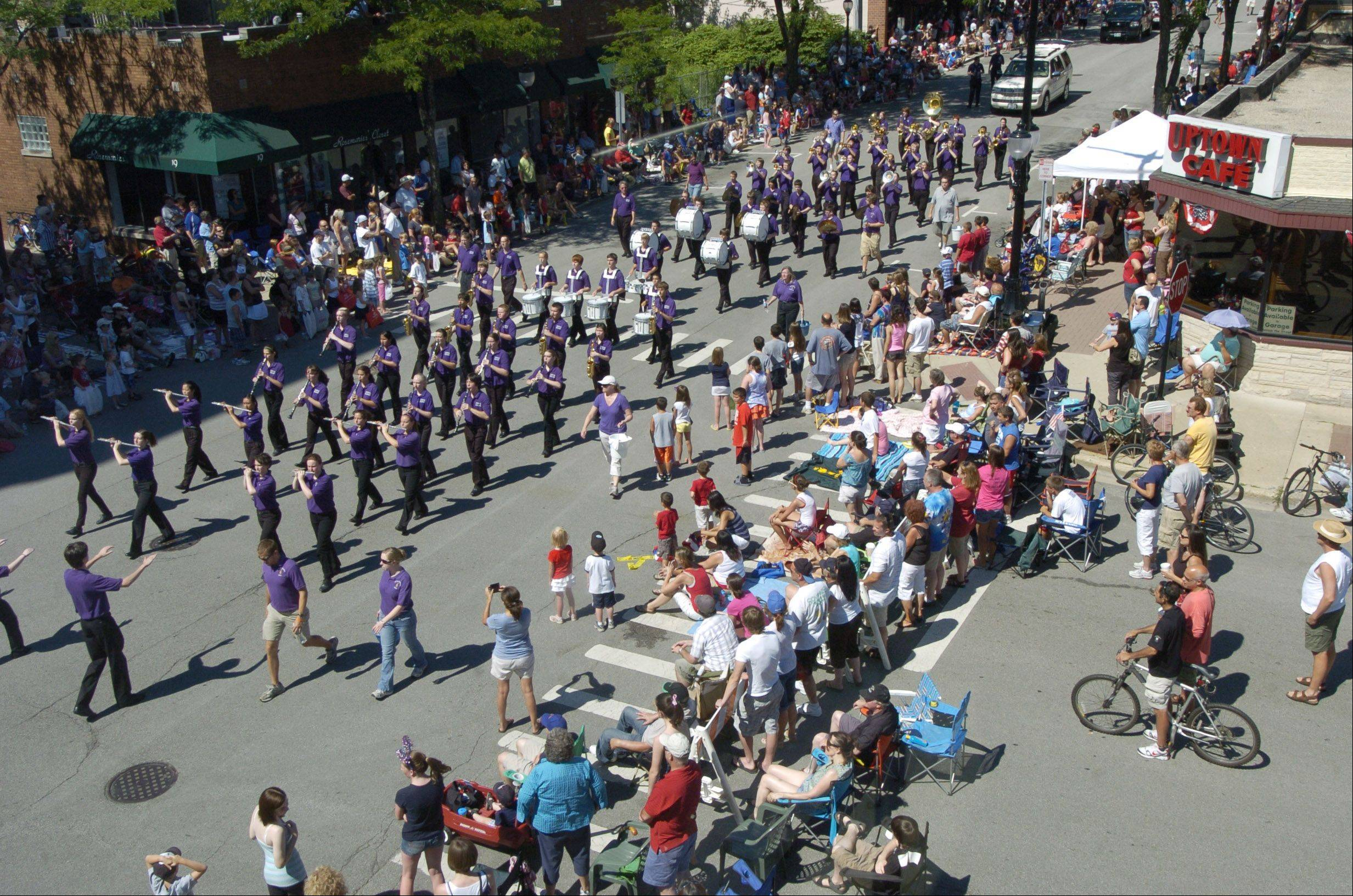 The Rolling Meadows High School marching band plays during the Arlington Heights Fourth of July parade Monday.