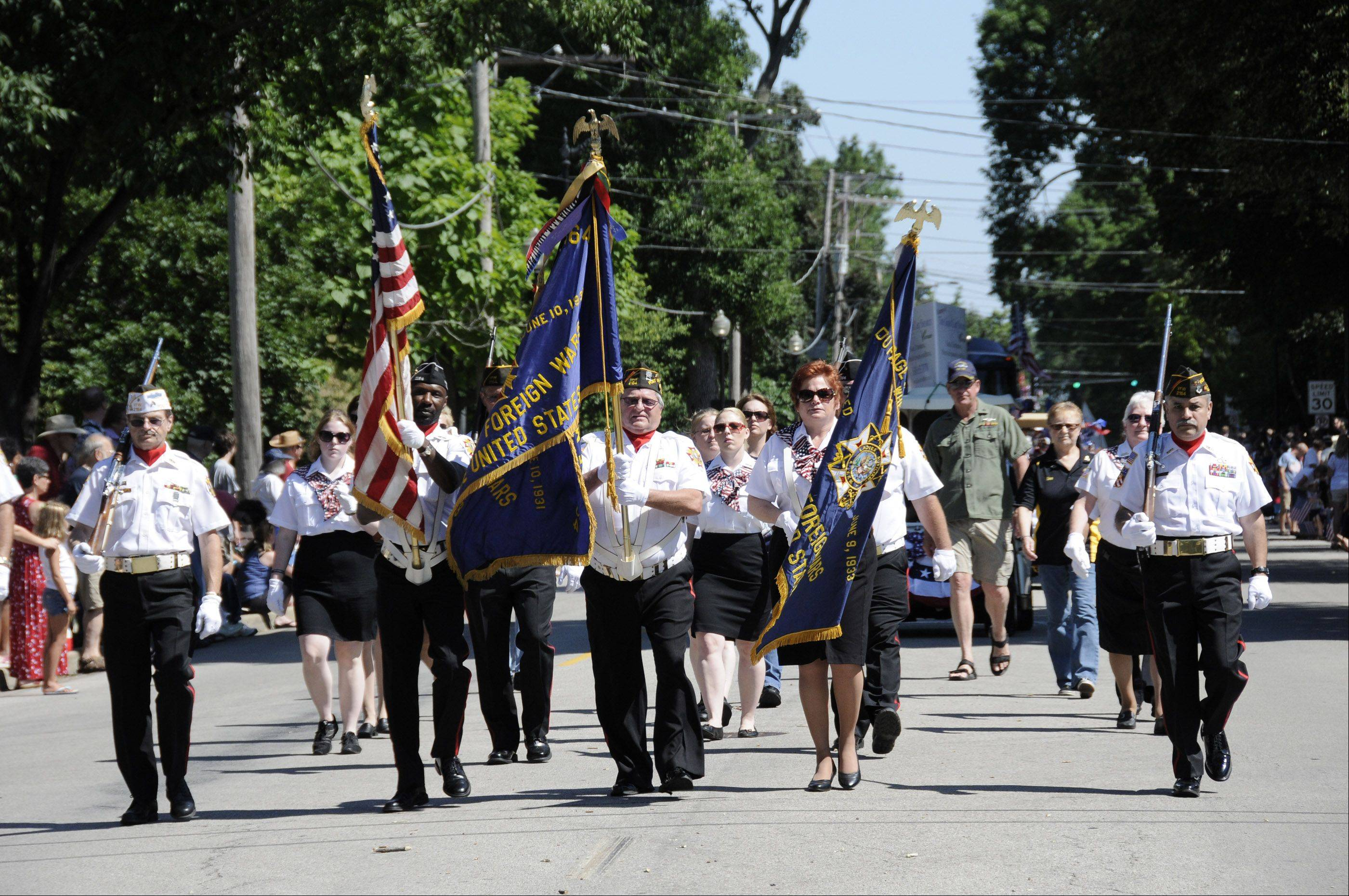 Wheaton's VFW Post 2164 members march down Main Street in Wheaton's Independence Day parade.