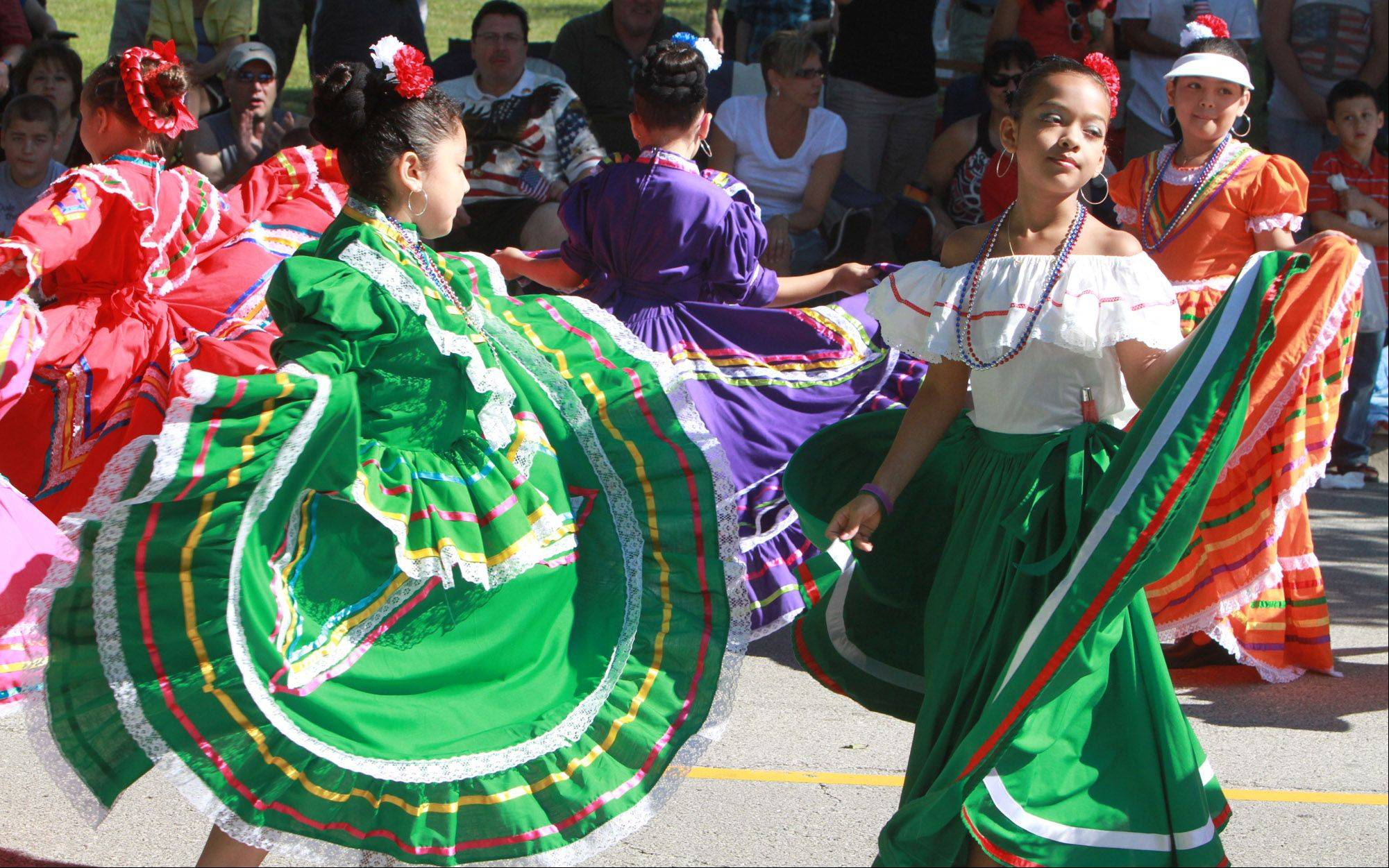 Grupo Folklorica Quetzal dances in the Hoffman Estates Fourth of July parade on Monday.