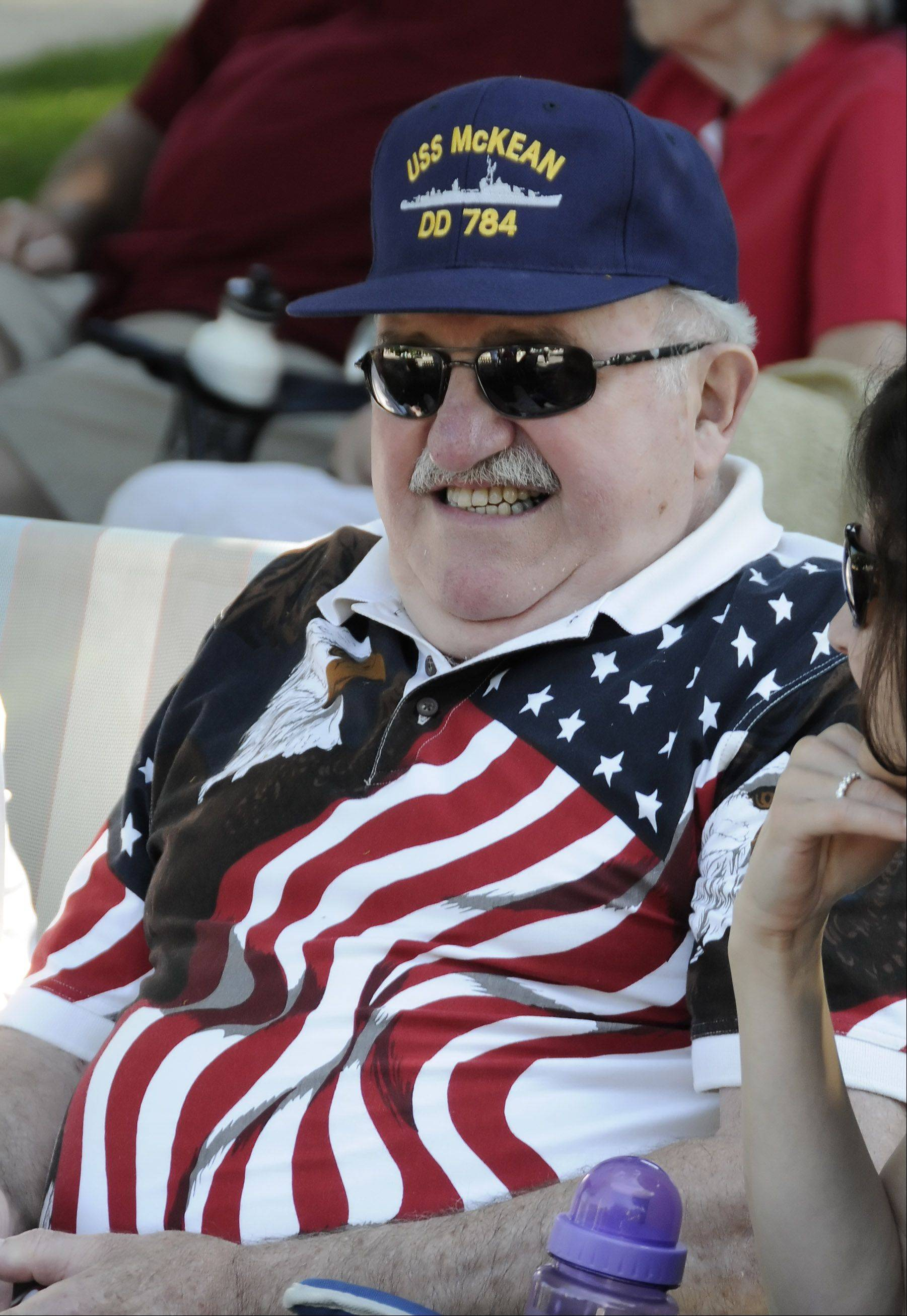 Robert Ciner from Aurora, sports a patriotic shirt while he watches several relatives march in Wheaton's Independence Day parade.