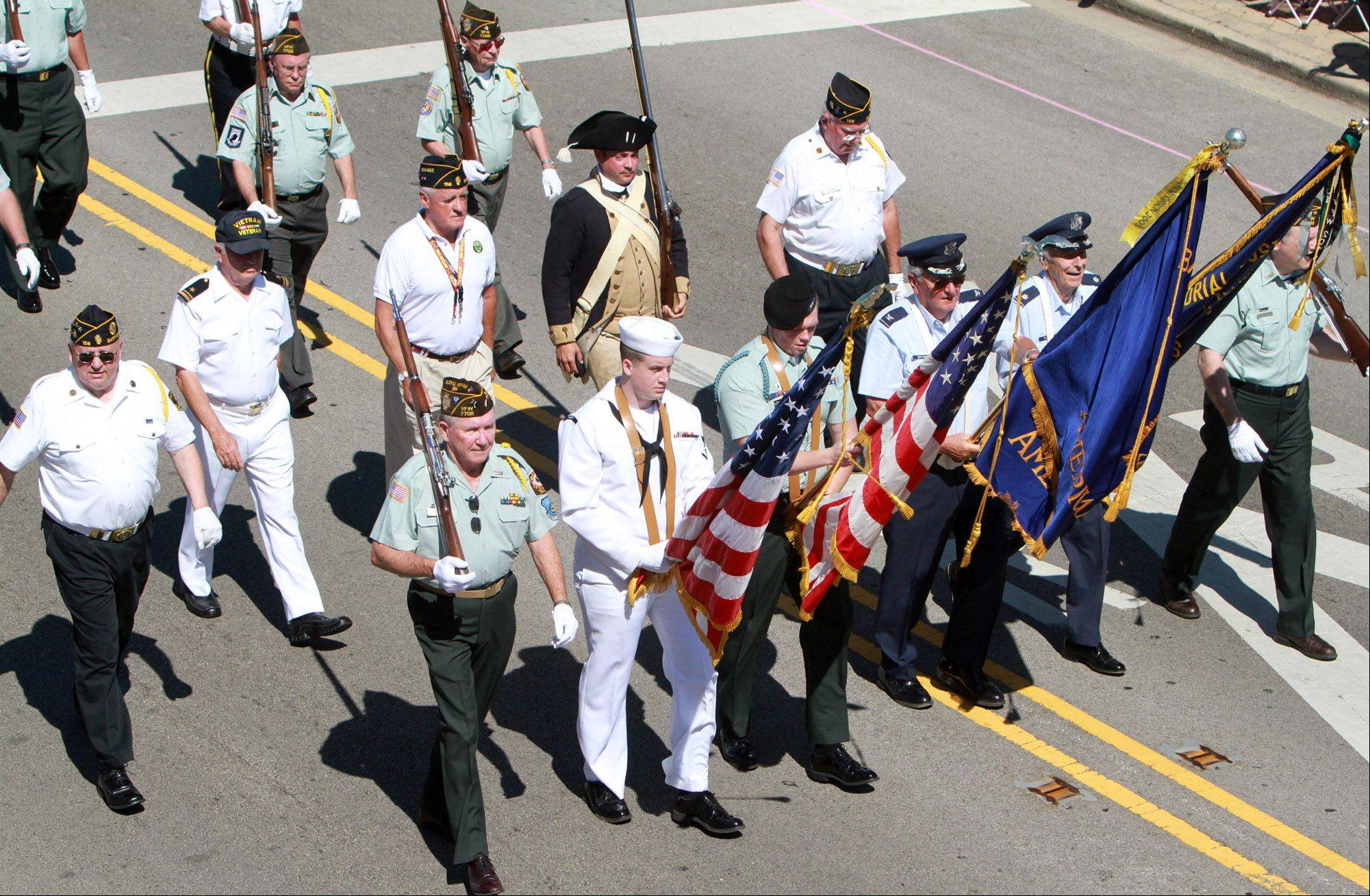 Color guard leads the way in the Barrington Fourth of July parade traveling east on Main Street on Monday.