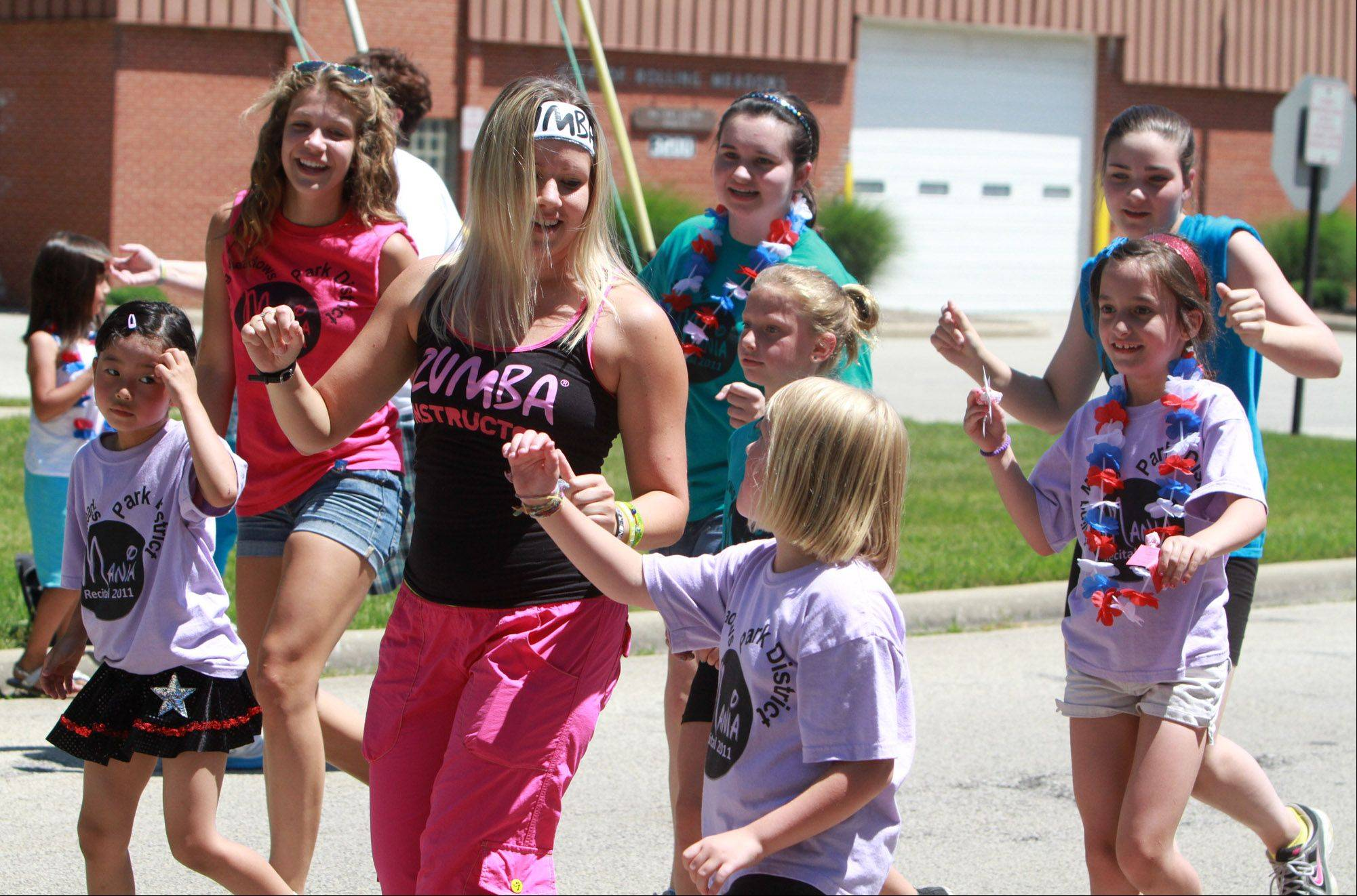 Dancers with Rolling Meadows Park District Dance Company march in the Rolling Meadows Fourth of July parade on Monday.