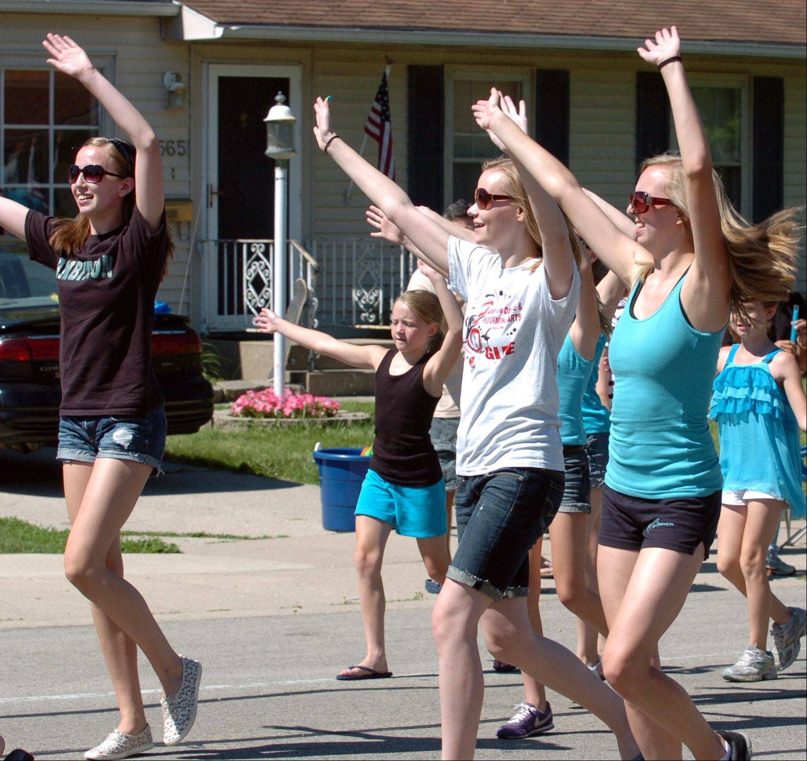 The Ambition Dance & Performing Arts of South Elgin, danced their way through the South Elgin Fourth of July Parade down Spring Street.