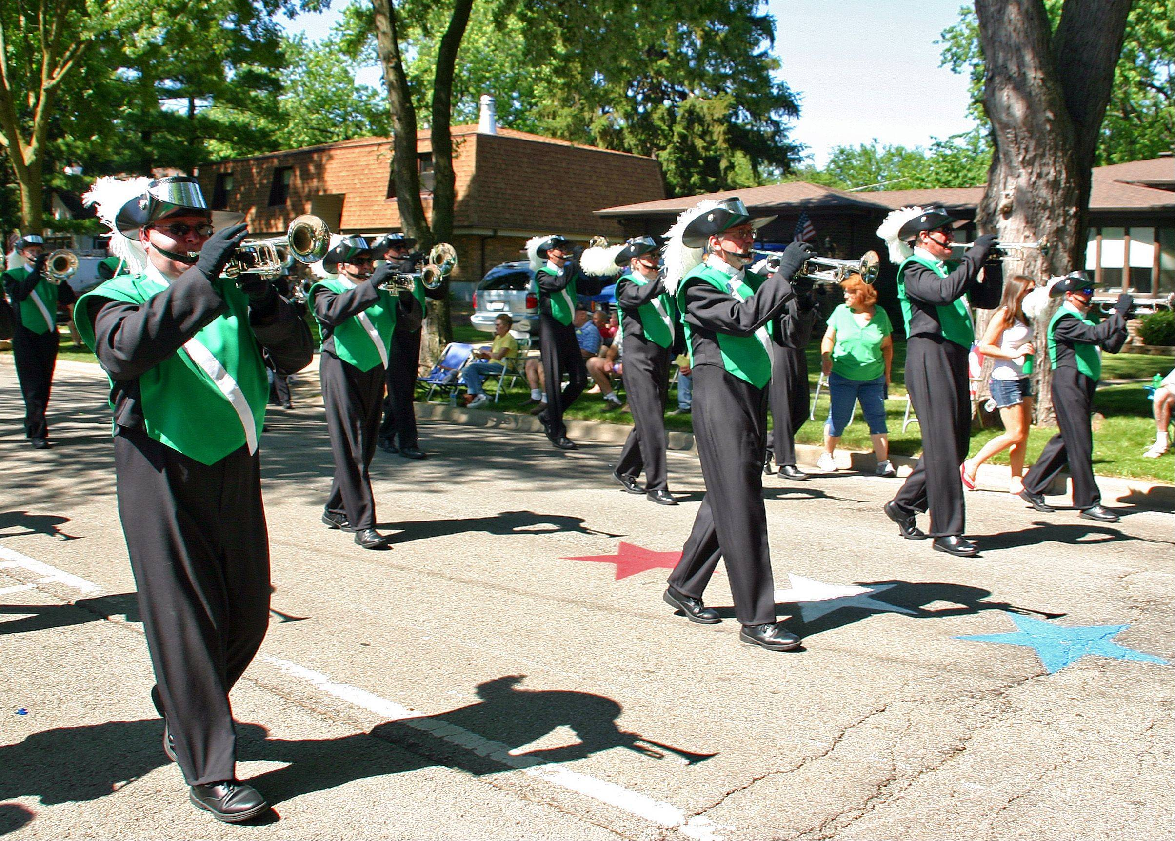 Classic Cavaliers march down Center Street playing patriotic tunes in the Des Plaines Fourth of July Parade.
