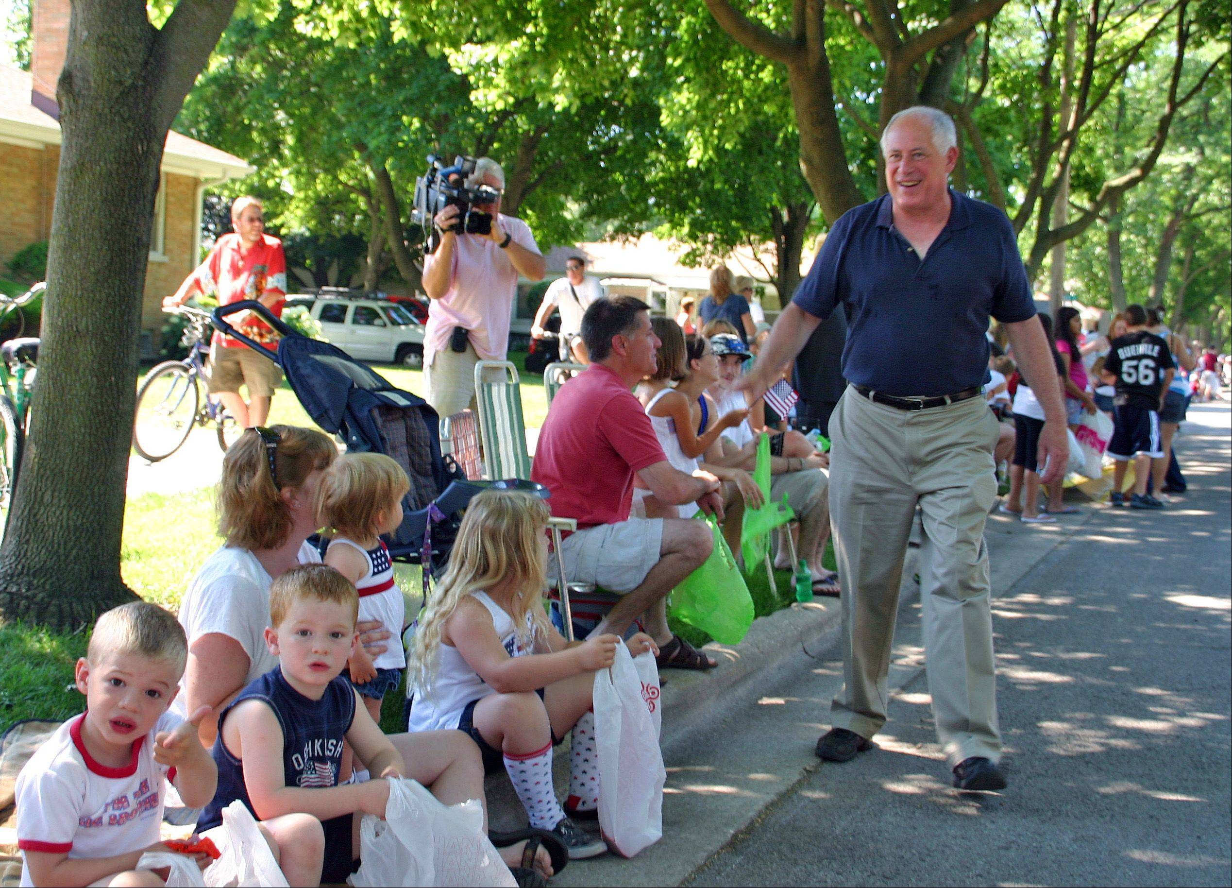Illinois Governor Pat Quinn walks down Center Street in the Des Plaines 2011 Independence Day Parade Monday, July 4, 2011.
