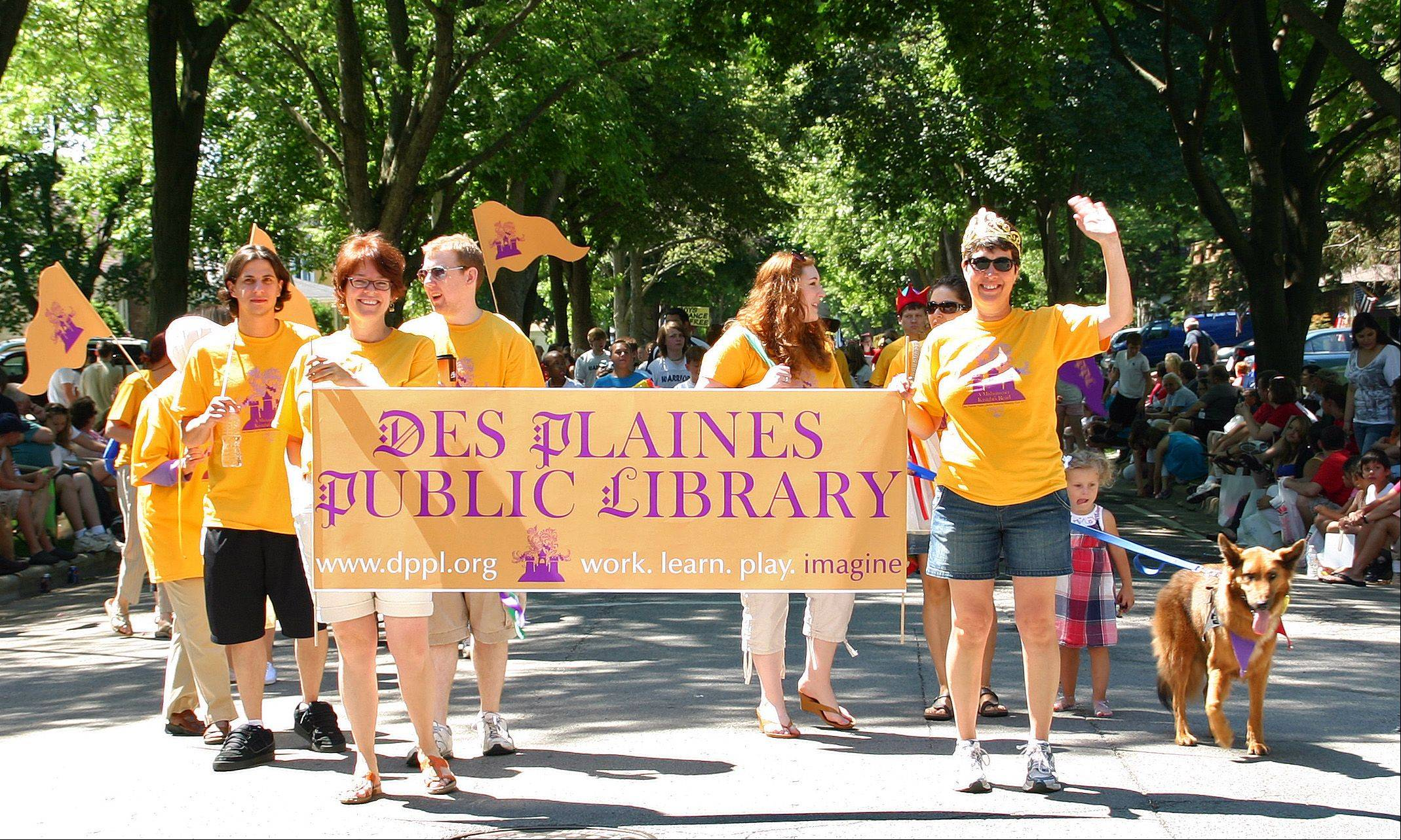 The Des Plaines Public Library Librarians handed out library card forms and information about their summer reading programs in the 2011 Independence Day Parade in Des Plaines.