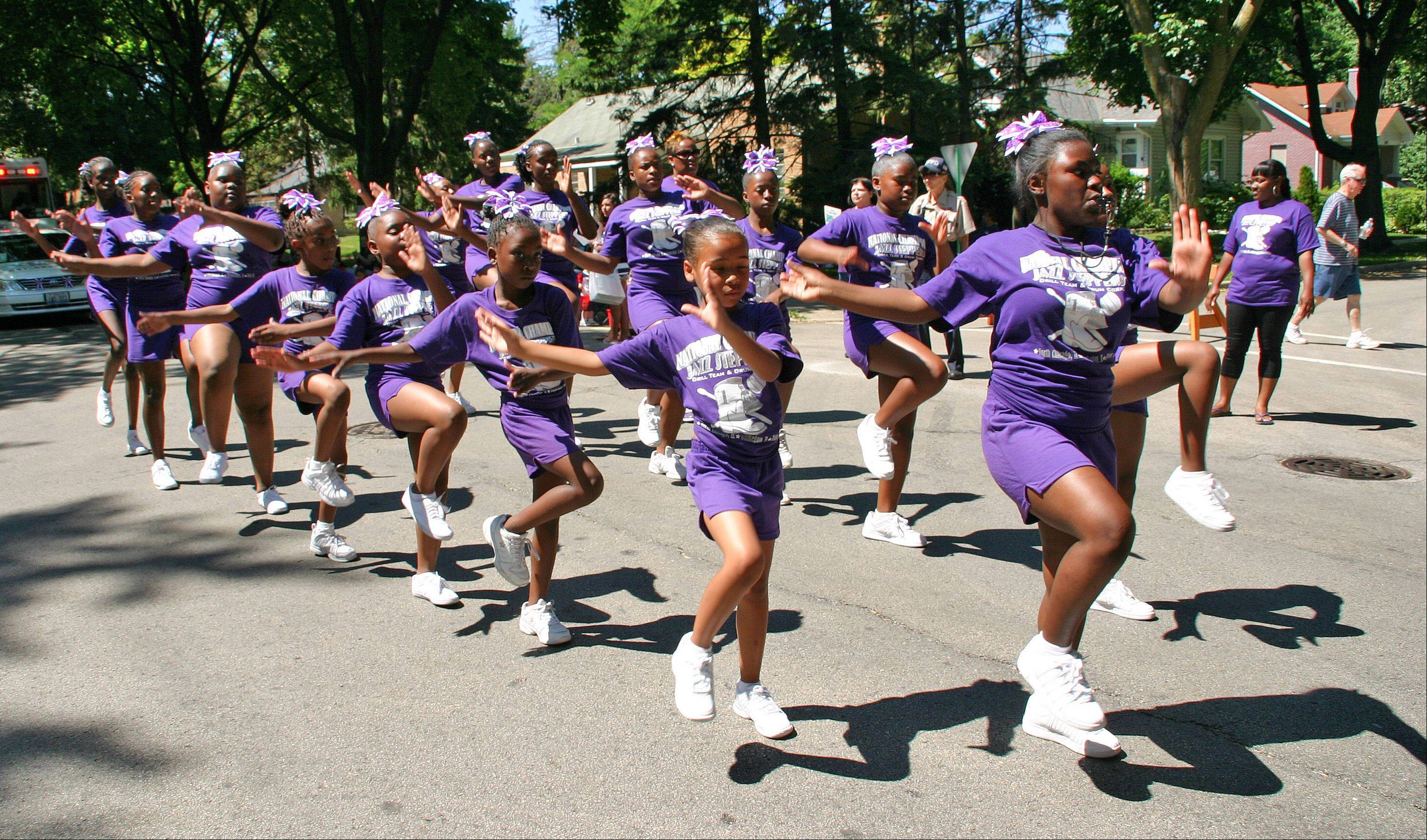 The National Champions Jazz Steppers Drill Team and Drum Corps perform for the crowds in the 2011 Independence Day Parade in Des Plaines.