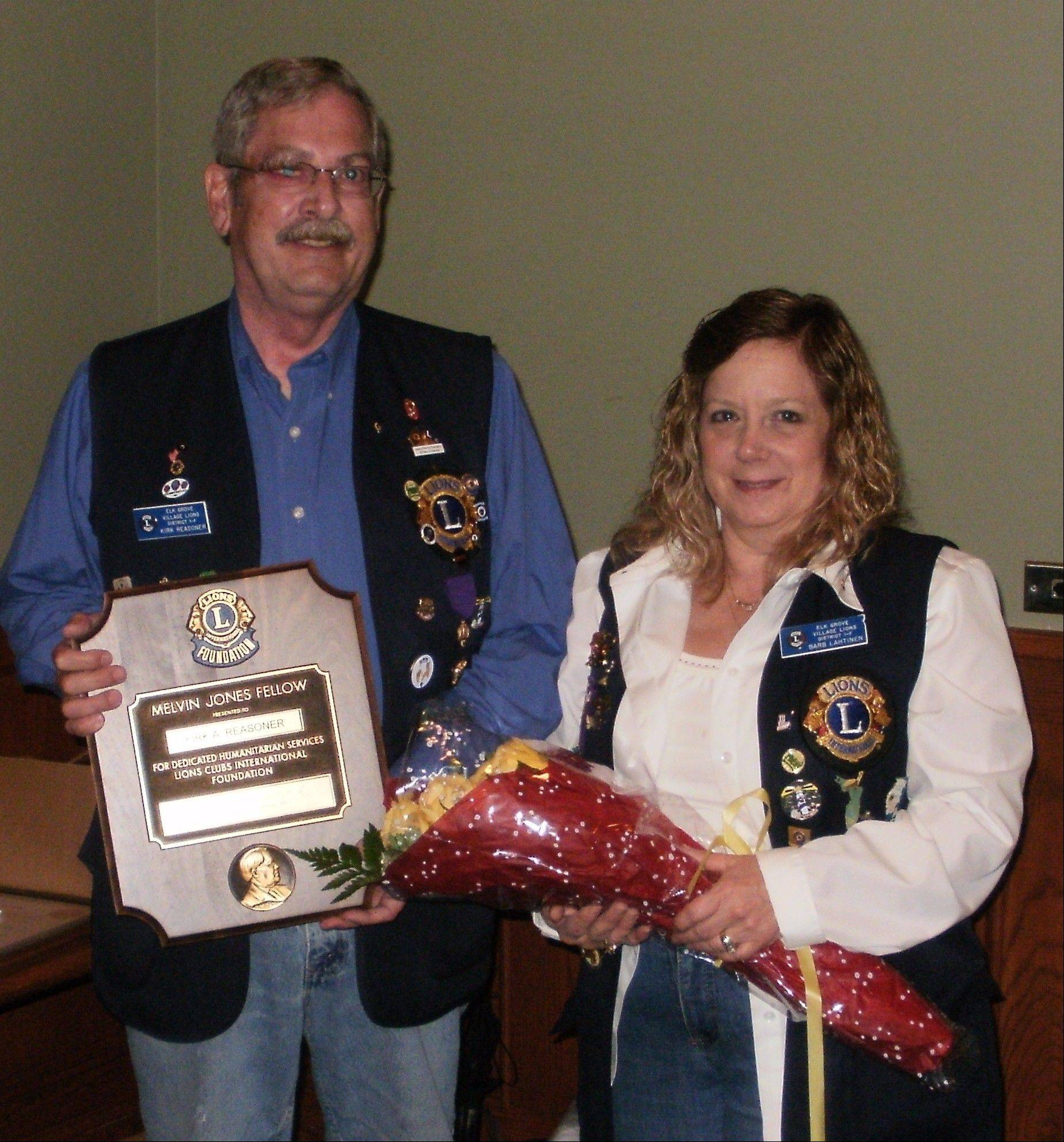 Outgoing President Barb Lahtinen and Melvin Jones recipient Kirk Reasoner.