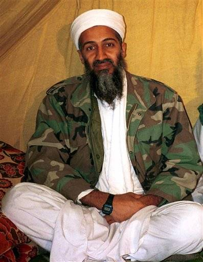 This undated photo shows then-al Qaida leader Osama bin Laden, in Afghanistan. After Navy SEALs killed Osama bin Laden, the White House released a photo of President Barack Obama and his cabinet inside the Situation Room, watching the daring raid unfold. Hidden from view, standing just outside the frame of that instantly iconic photograph was a career CIA analyst. In the hunt for the world's most-wanted terrorist, there may have been no one more important. His job for nearly a decade: finding bin Laden.