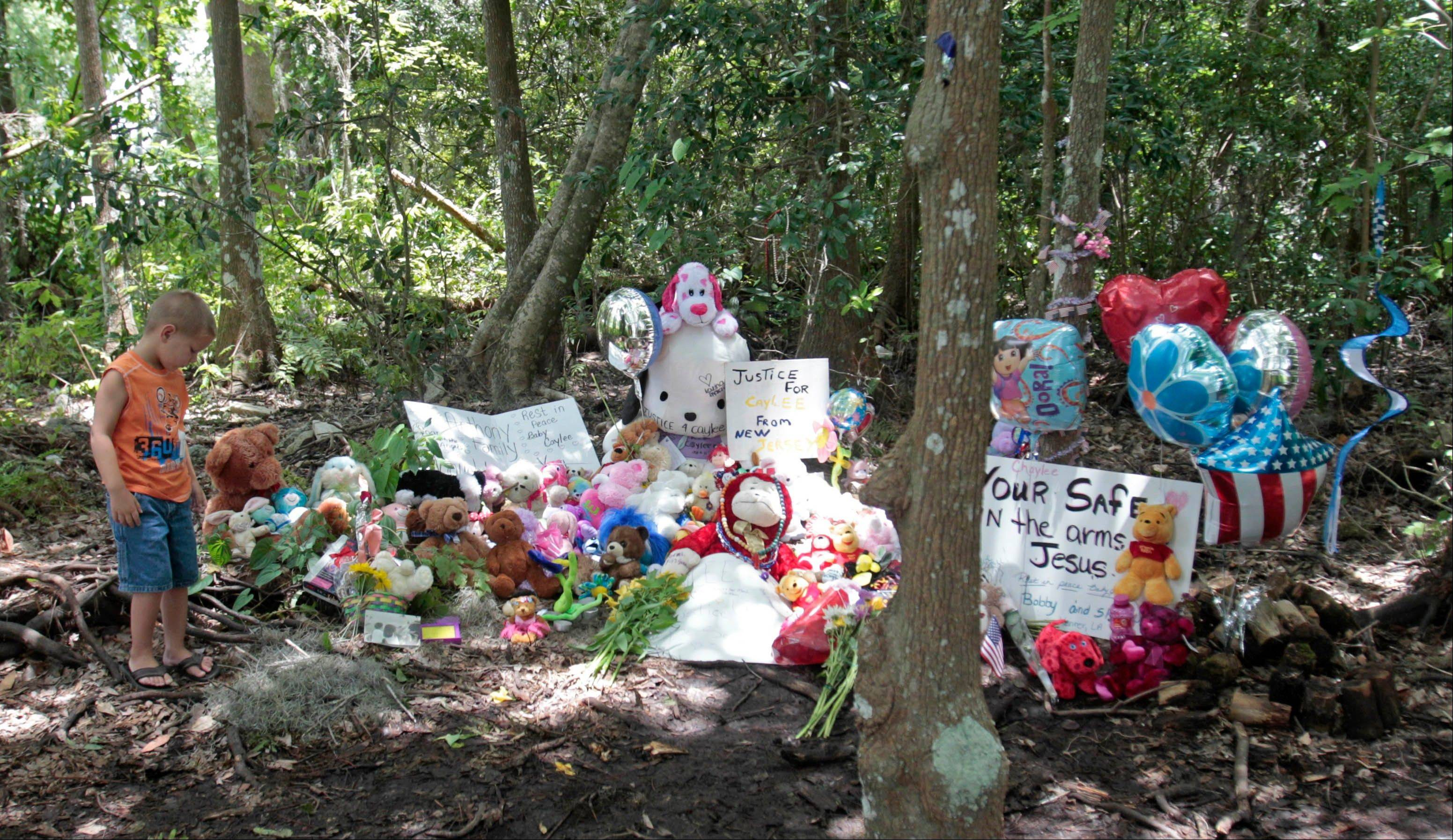 Mark Likins, of Thomasville, Ga., visits the memorial of Caylee Anthony before Casey Anthony was found not guilty of first-degree murder, aggravated manslaughter and aggravated child abuse in Orlando, Fla., Tuesday.