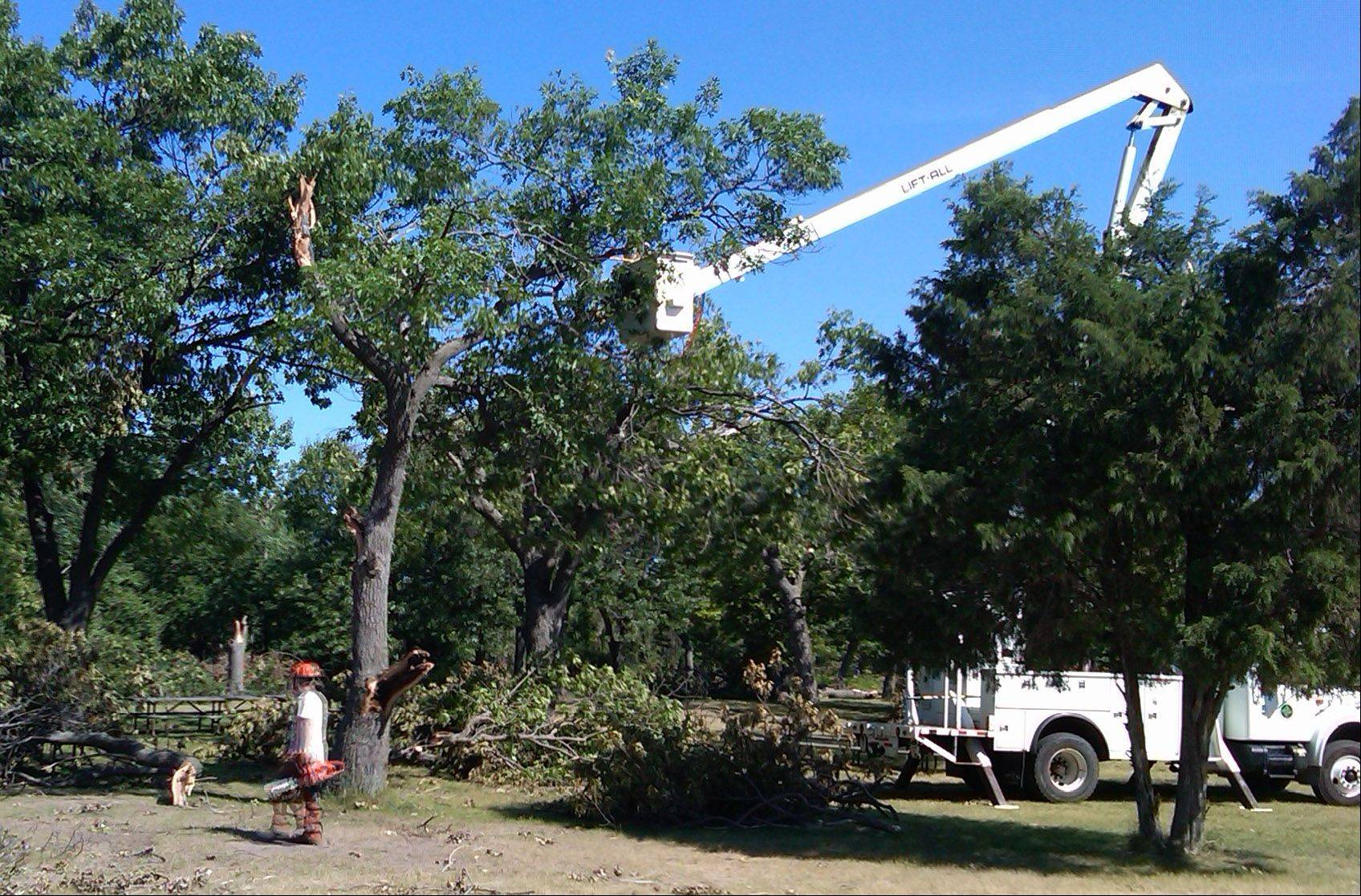 The Lake County Forest Preserve District provided crews and equip Tuesday to assist in the clean up from storm damage at Adeline Jay Geo-Karis Illinois Beach State Park.