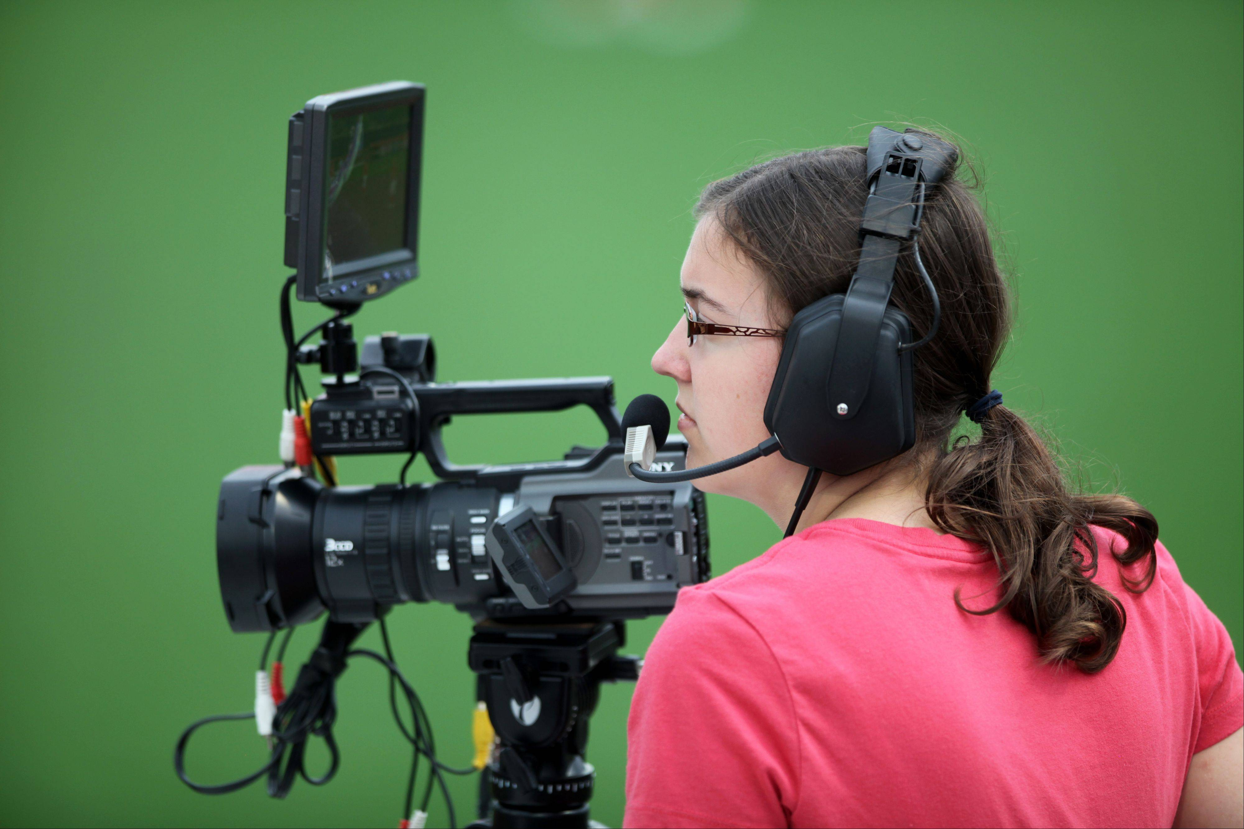 Emily Rawsem, of Bartlett, works the first base video camera at Thursday's Chicago Bandits Game.