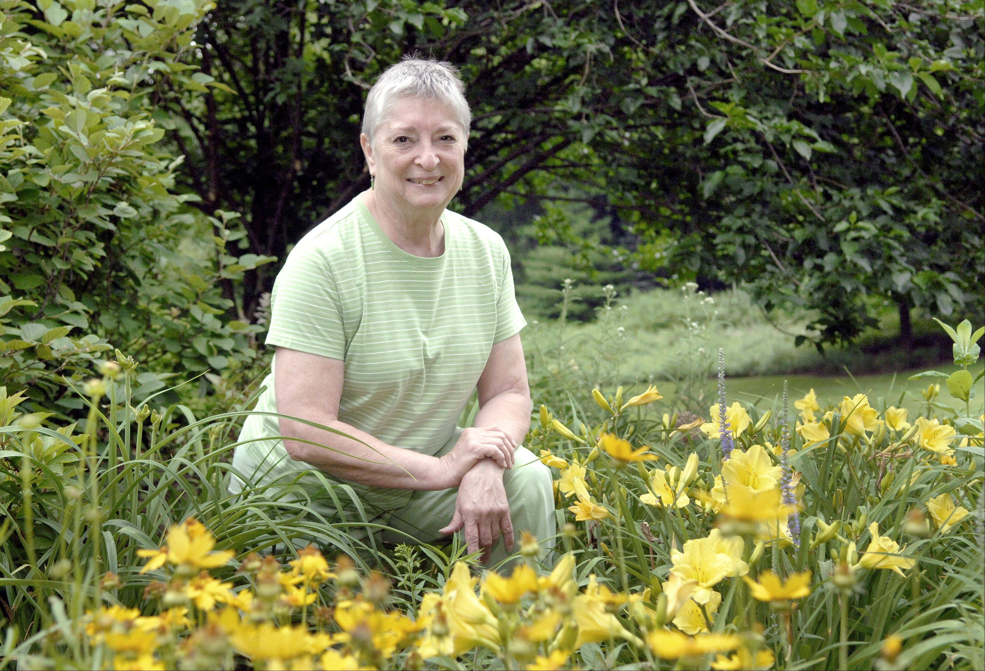 St. Charles master gardener Nancy Cox at her home in St. Charles. Cox says she spends the entire summer in her garden.