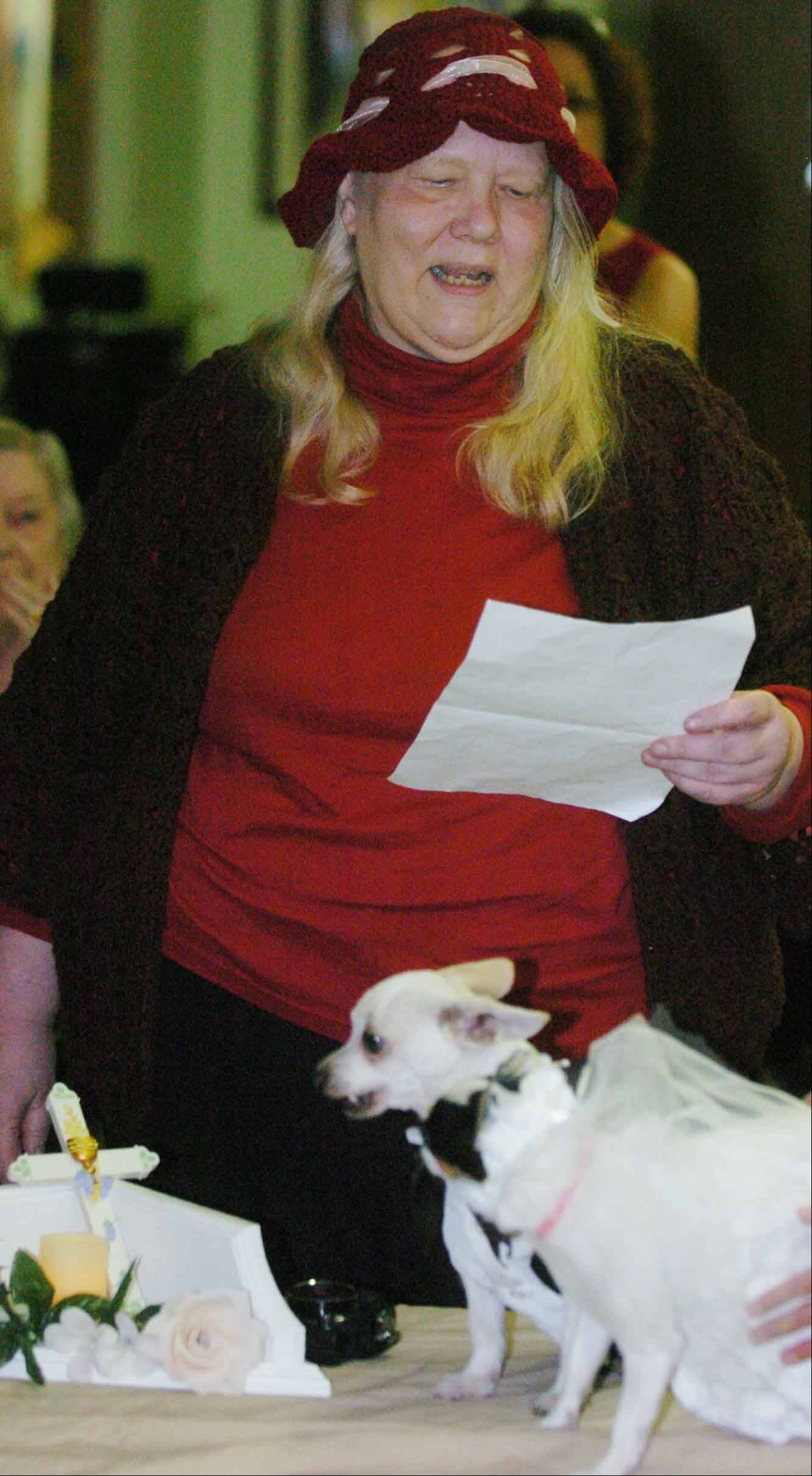 Resident Carol Brinkman conducts the service for the dog wedding at the DuPage Convalescent Center in Wheaton.