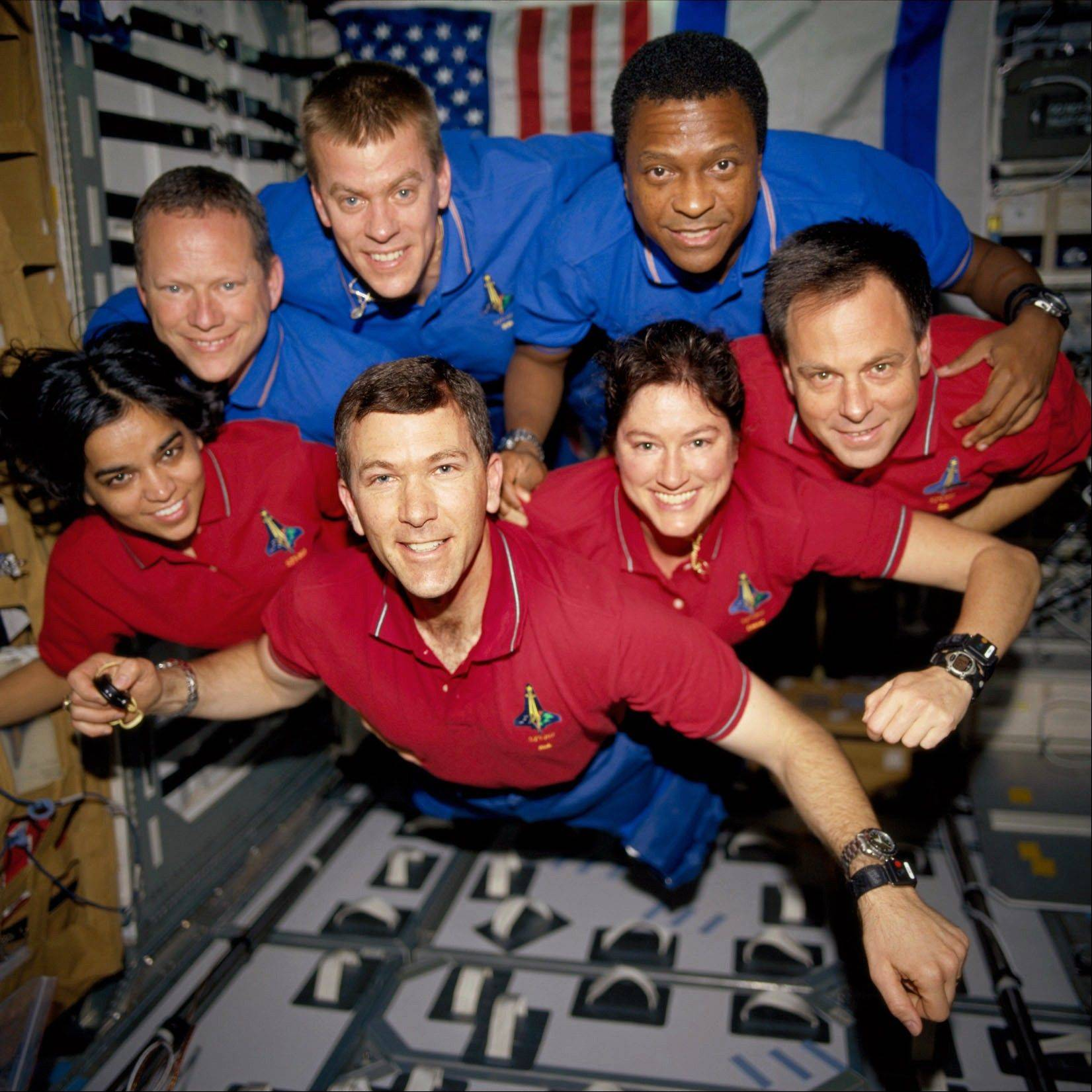 This photo provided by NASA in June 2003 shows STS-107 crew members in the SPACEHAB Research Double Module (RDM) aboard the Space Shuttle Columbia. On Feb. 1, 2003, the seven crew members were lost as the Columbia fell apart over East Texas. This picture was on a roll of unprocessed film later recovered by searchers from the debris. From the left (bottom row), wearing red shirts to signify their shiftís color, are astronauts Kalpana Chawla, mission specialist; Rick D. Husband, mission commander; Laurel B. Clark, mission specialist; and Ilan Ramon, payload specialist. From the left (top row), wearing blue shirts, are astronauts David M. Brown, mission specialist; William C. McCool, pilot; and Michael P. Anderson, payload commander. Ramon represents the Israeli Space Agency.