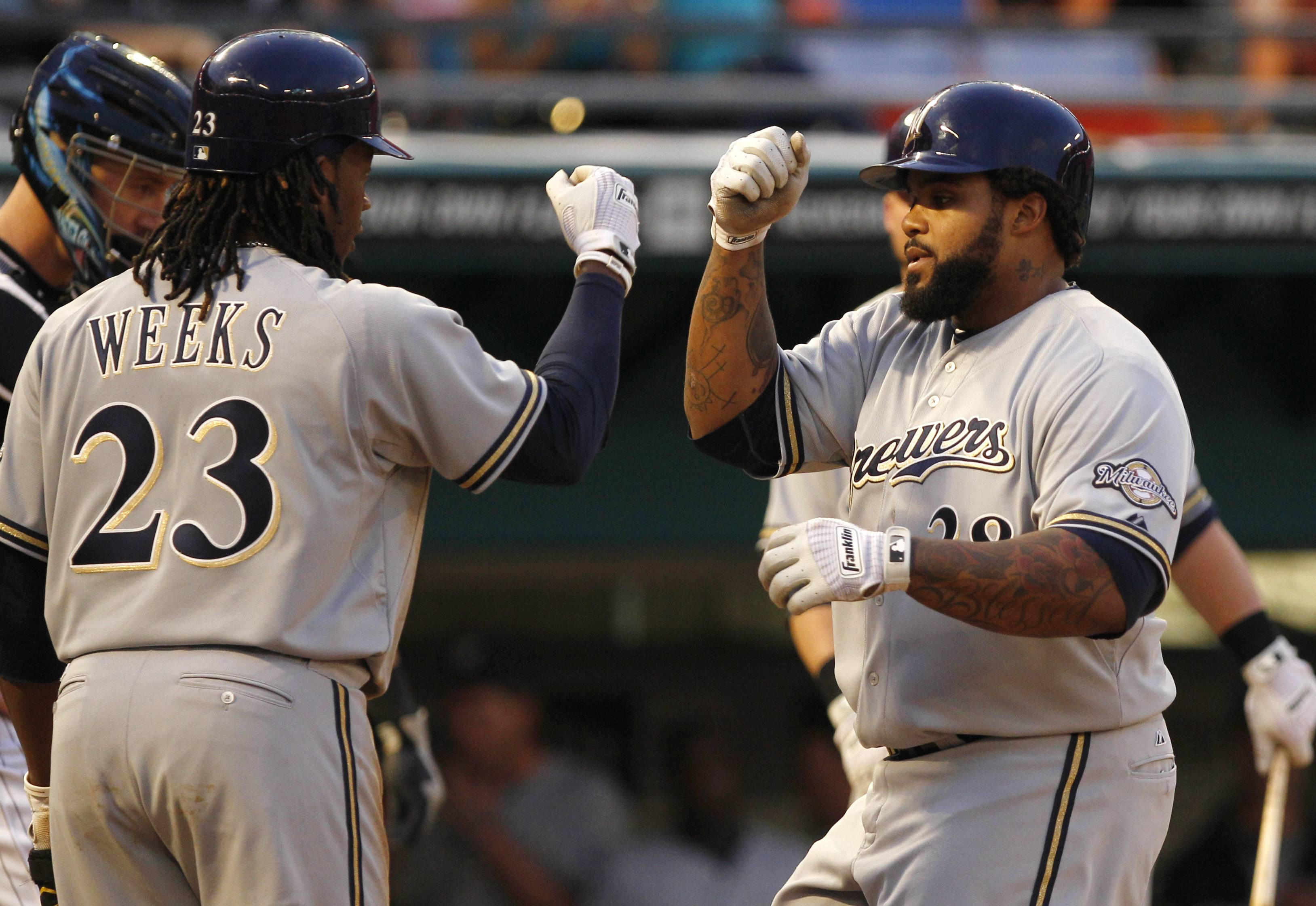 Milwaukee Brewers slugger Prince Fielder, right, selected teammate Rickie Weeks, Los Angeles' Matt Kemp and St. Louis' Matt Holliday to represent the National League in Monday night's Home Run Derby.
