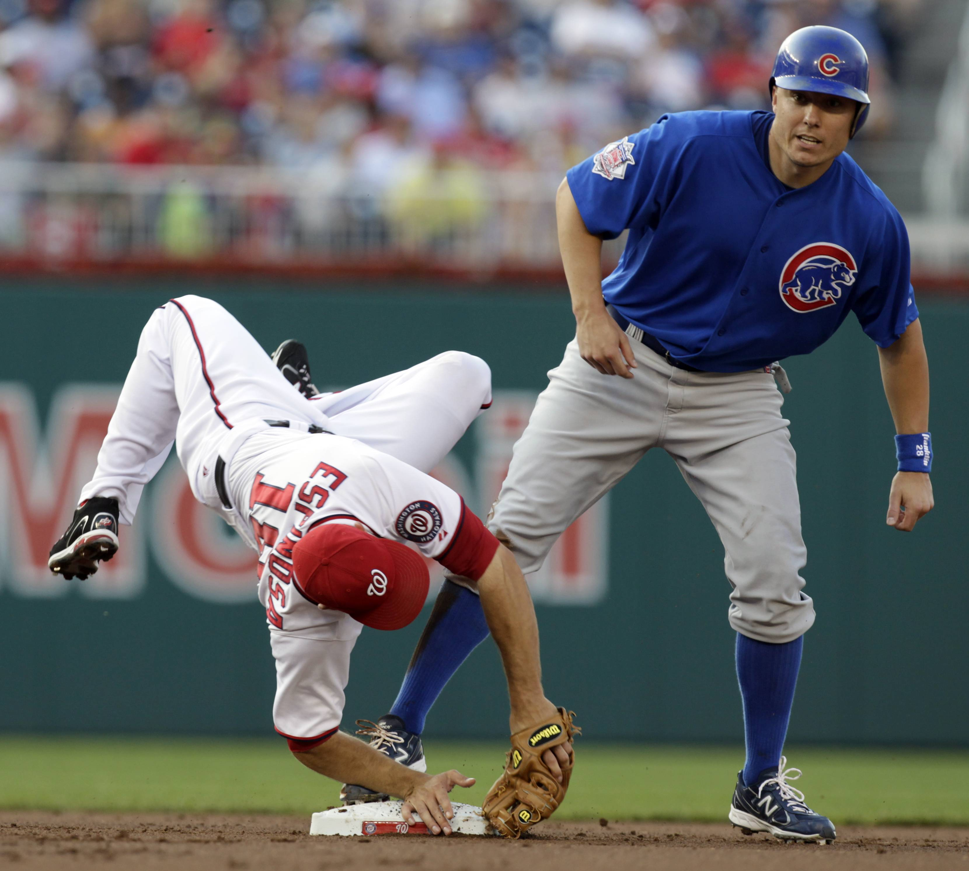 Washington Nationals second baseman Danny Espinosa is upended by the Cubs' Jeff Baker during the first inning at Nationals Park on Tuesday. Baker was out on the play.