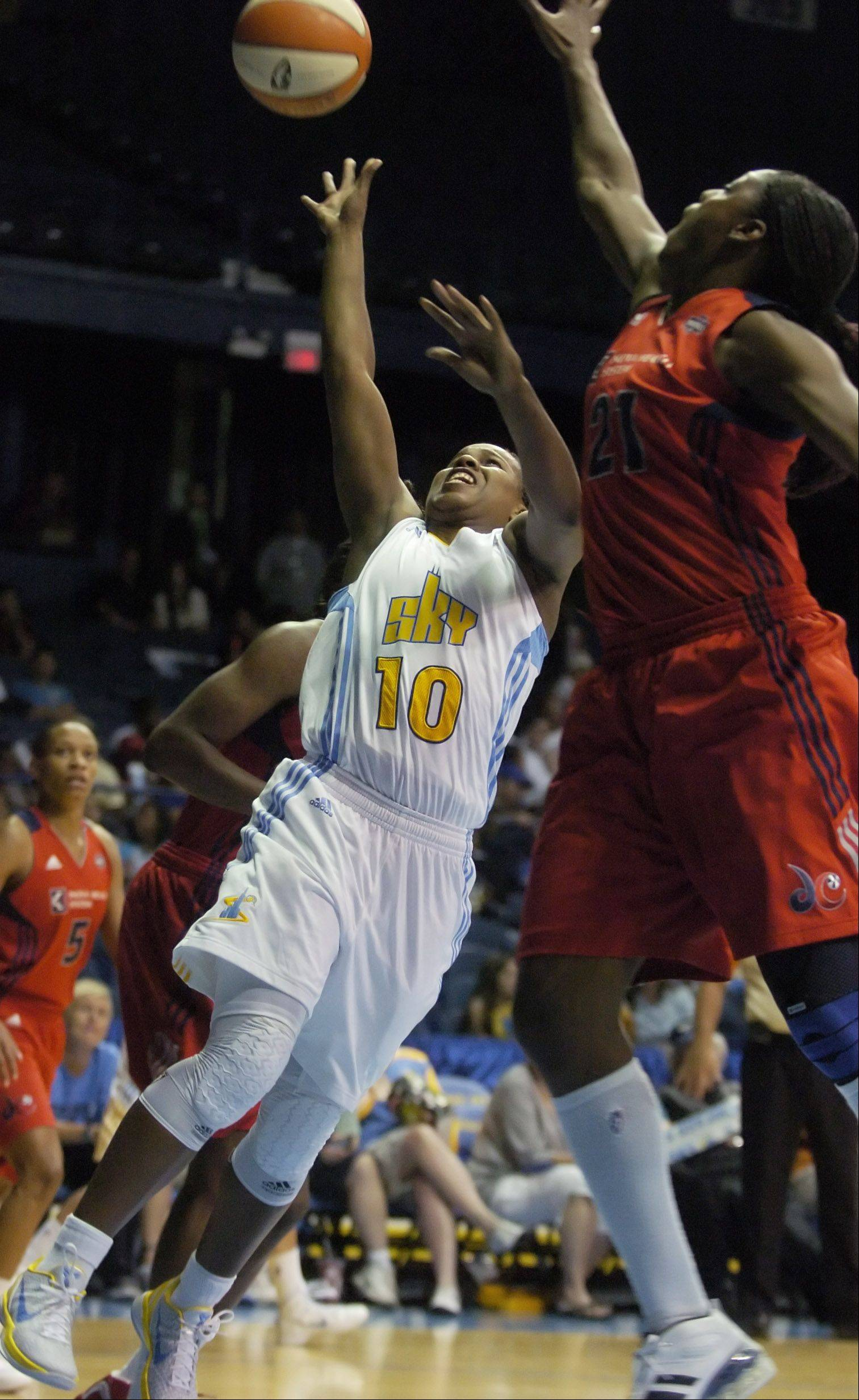 Epiphanny Prince of the Chicago Sky takes an off-balance shot as Nicky Anosike of the Washington Mystics defends during Tuesday's game at the Allstate Arena in Rosemont.