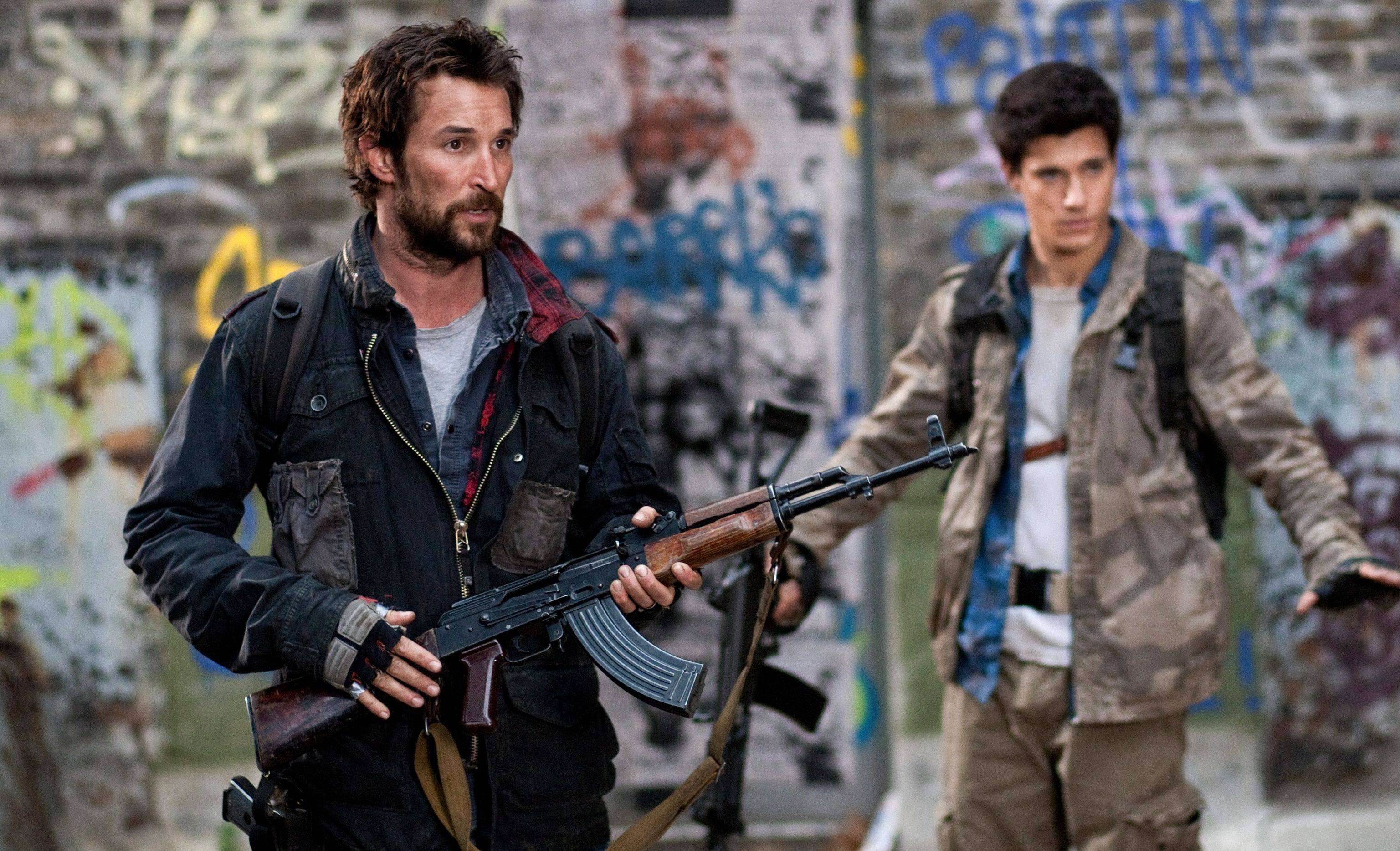 "Noah Wyle, left, and Drew Roy in the new sci-fi series ""Falling Skies"" on TNT."