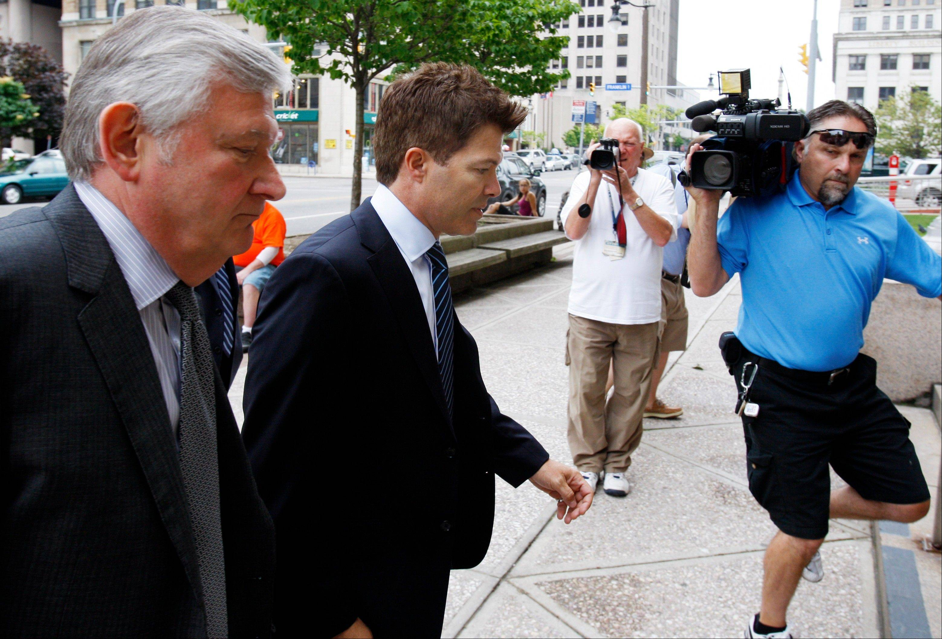 Dr. Anthony Galea, center, arrives at federal court in Buffalo, N.Y., Wednesday, July 6. The Toronto doctor was indicted in October on charges he smuggled in human growth hormone and other substances and lied to border agents to avoid getting caught. (AP Photo/David Duprey)