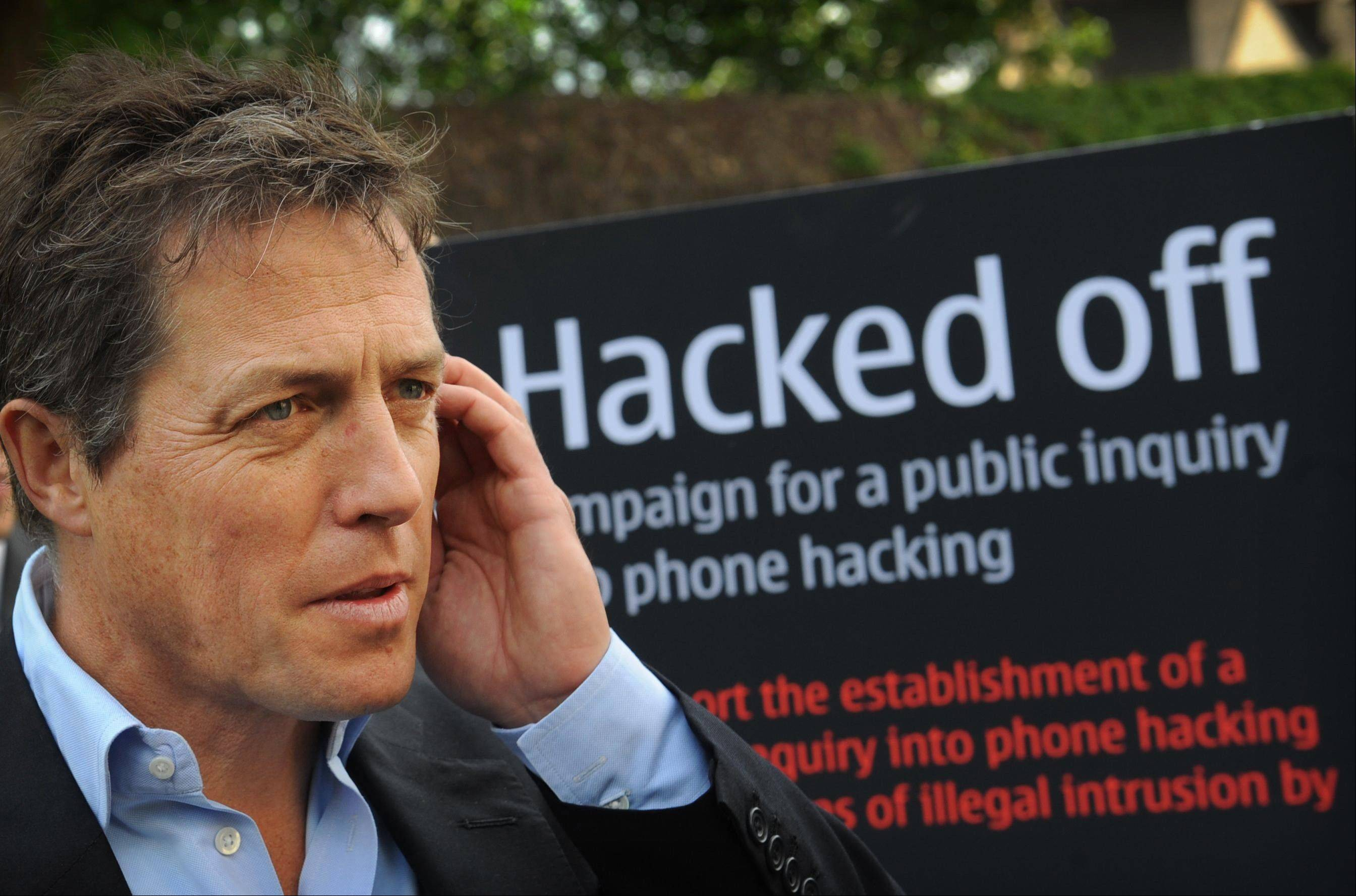 "British actor Hugh Grant outside the Houses of Parliament in London, where a debate was being held into the allegations of phone hacking by journalists Wednesday. ""Newspapers were using phone hacking on a widespread and industrial basis ... (with) the apparent collusion of parts of the Metropolitan Police,"" actor Hugh Grant told BBC radio."