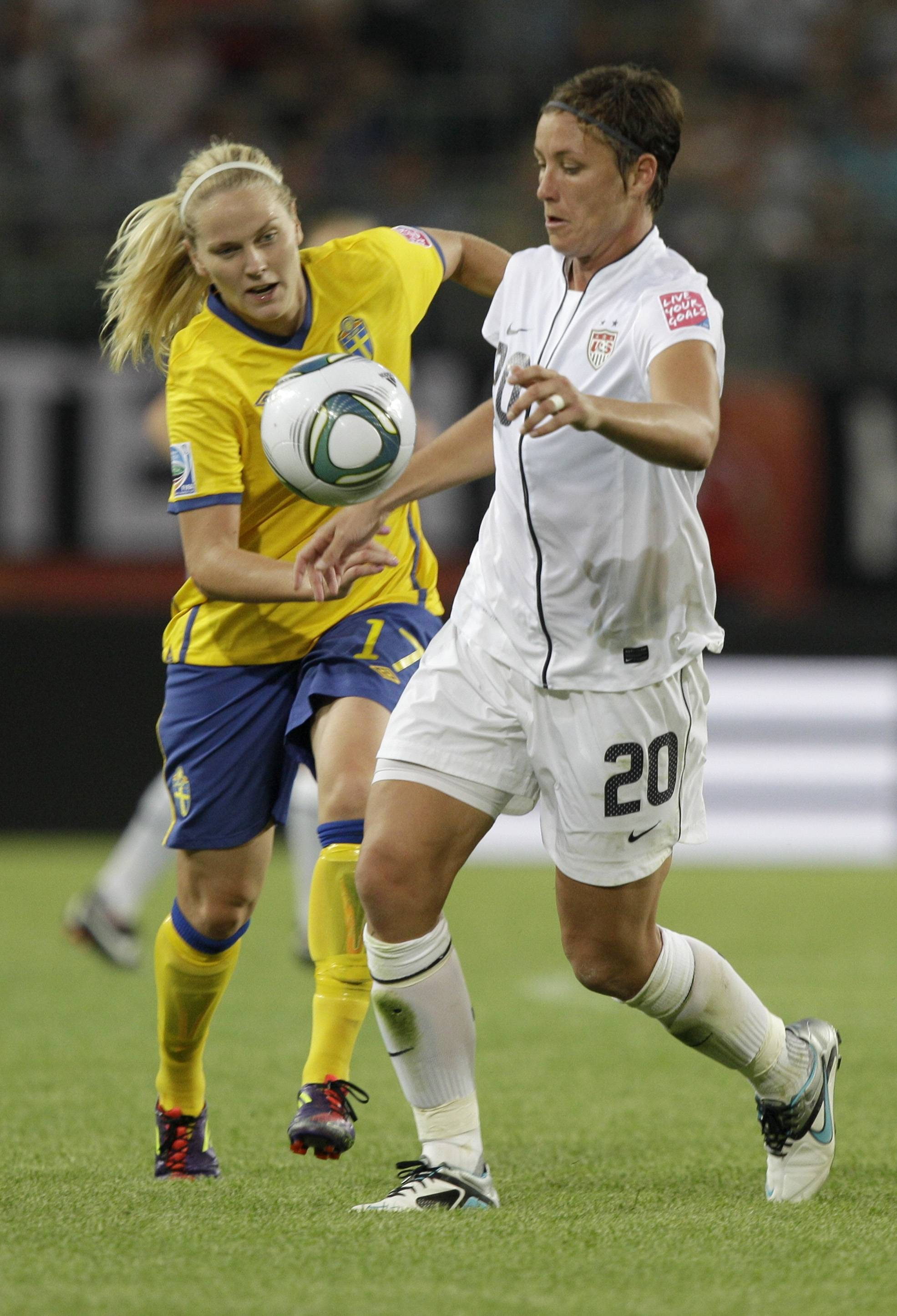 Abby Wambach and Sweden's Lisa Dahlkvist, left, challenge for the ball during the group C match between Sweden and the United States at the Women's Soccer World Cup in Wolfsburg, Germany, Wednesday.
