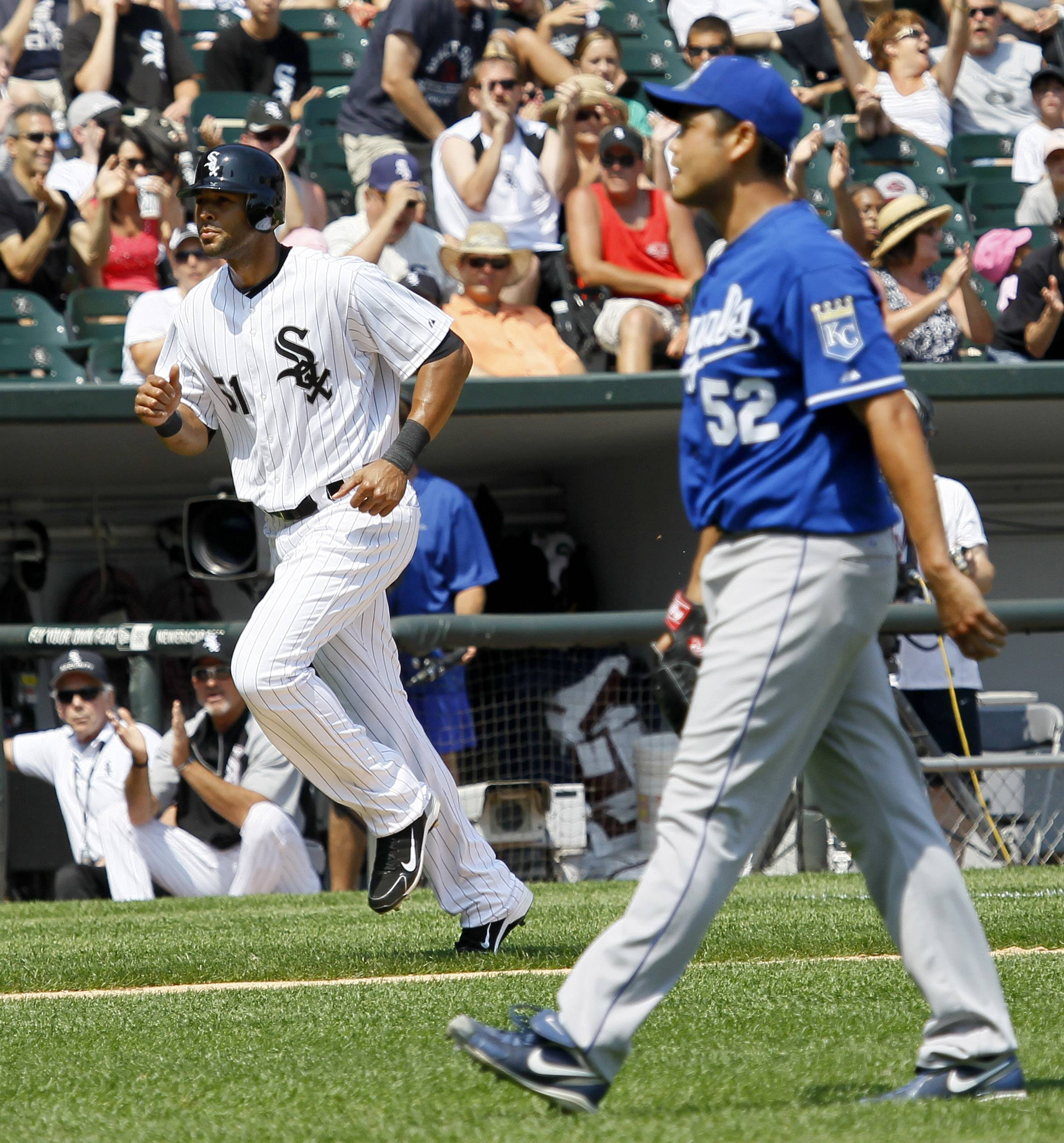 Alex Rios trots home to score after Kansas City Royals starting pitcher Bruce Chen walked Adam Dunn with the bases load Wednesday at U.S. Cellular Field.