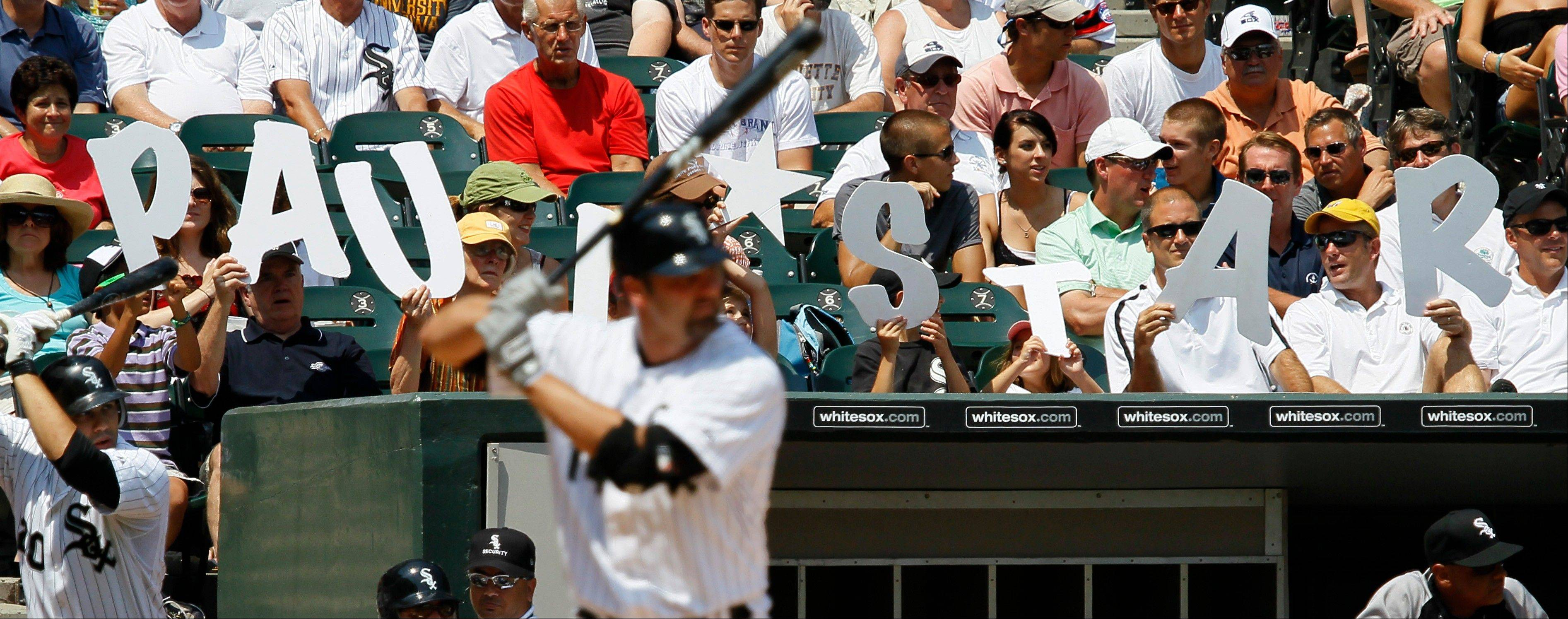 As part of an All Star Game voting promotion, fans hold up the words Paul Star, as the White Sox's Paul Konerko bats during the fourth inning Wednesday at U.S. Cellular Field.