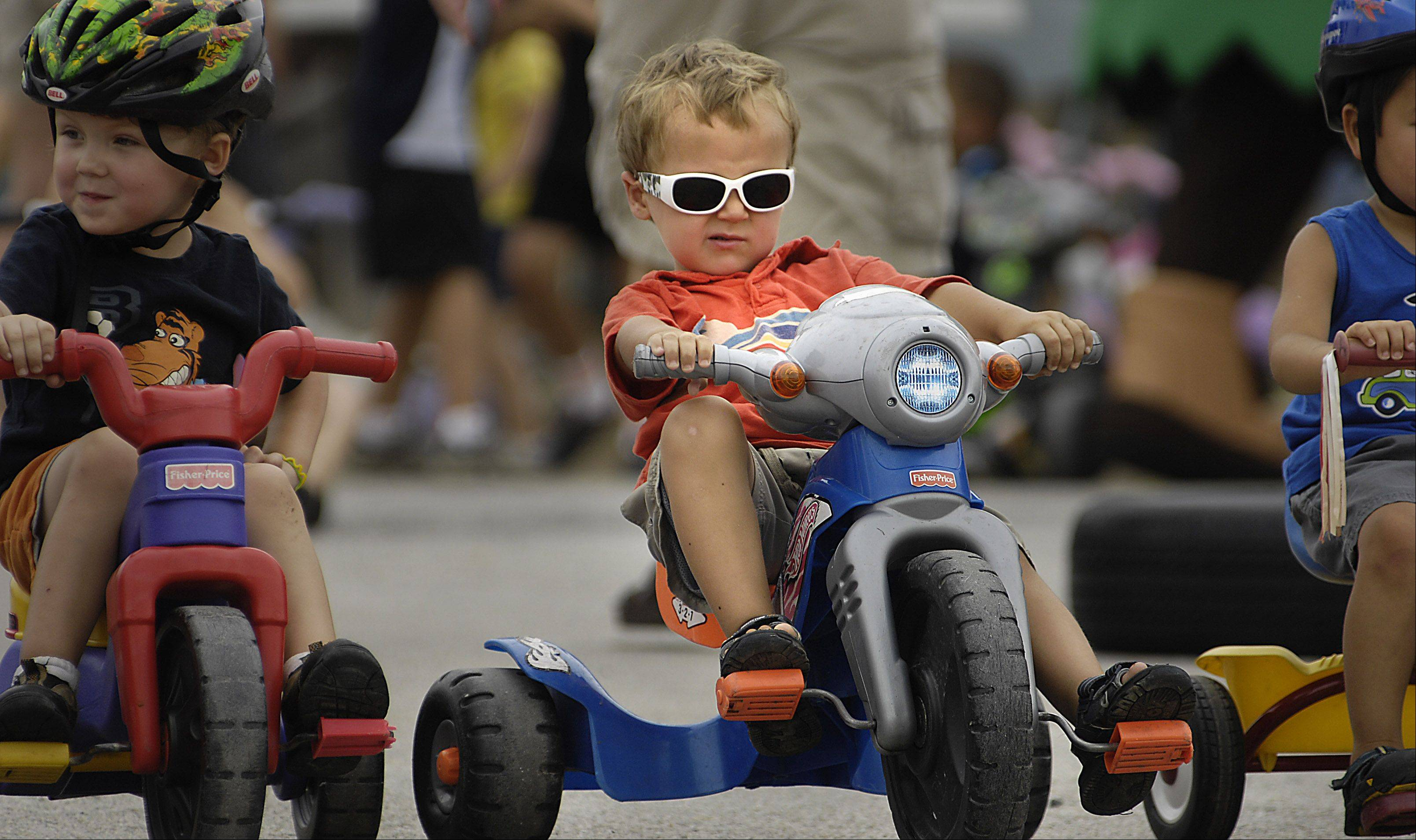 Kyle Vogtmann gets his game face on at the starting line of the 3-year-old Lil' 500 Big Wheel Race during last year's Batavia's Windmill City Festival. His sister Hailey won the 2-year-old race moments earlier. They were with their mother Colleen and are from Aurora.